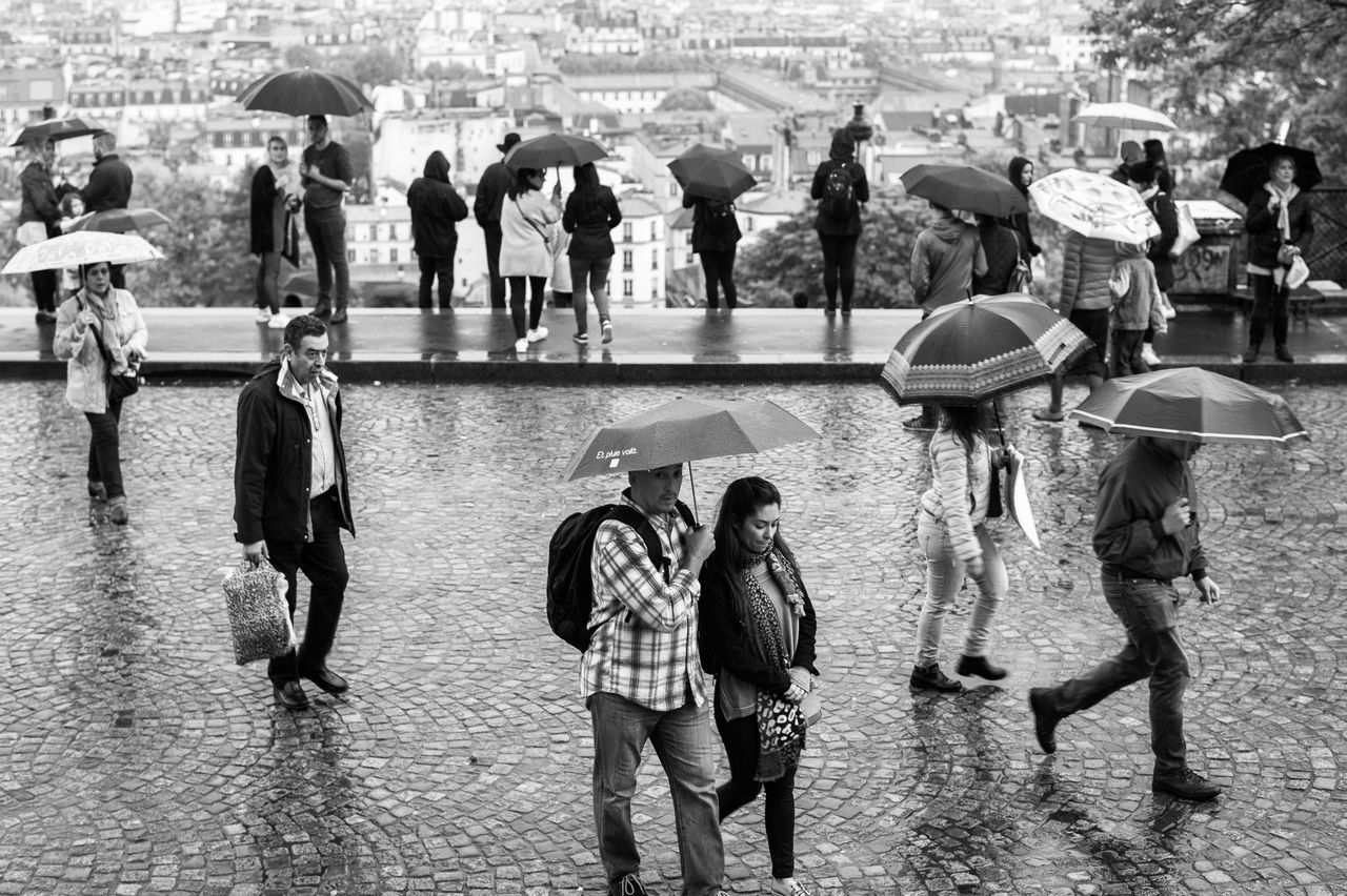 Rain in Paris. Adult Architecture Building Exterior Built_Structure Casual Clothing City City Life Crowd Day France Large Group Of People Leisure Activity Lifestyles Men Mixed Age Range Outdoors Paris Rain Real People Street Photography The Street Photographer - 2017 EyeEm Awards Walking Water Let's Go. Together.