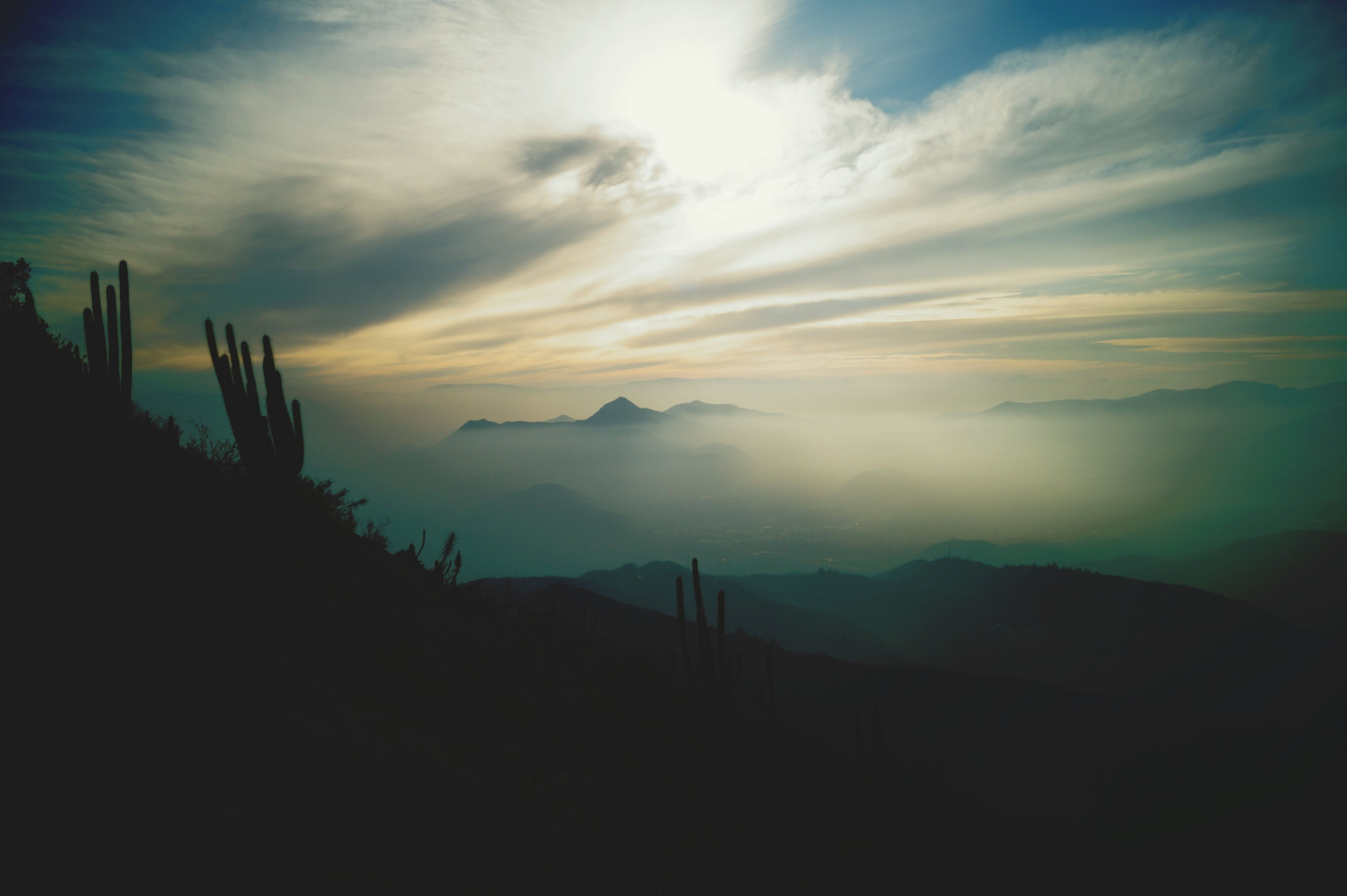 sky, silhouette, tranquil scene, scenics, tranquility, beauty in nature, cloud - sky, mountain, sunset, nature, cloudy, landscape, cloud, idyllic, mountain range, dusk, weather, outdoors, non-urban scene, no people