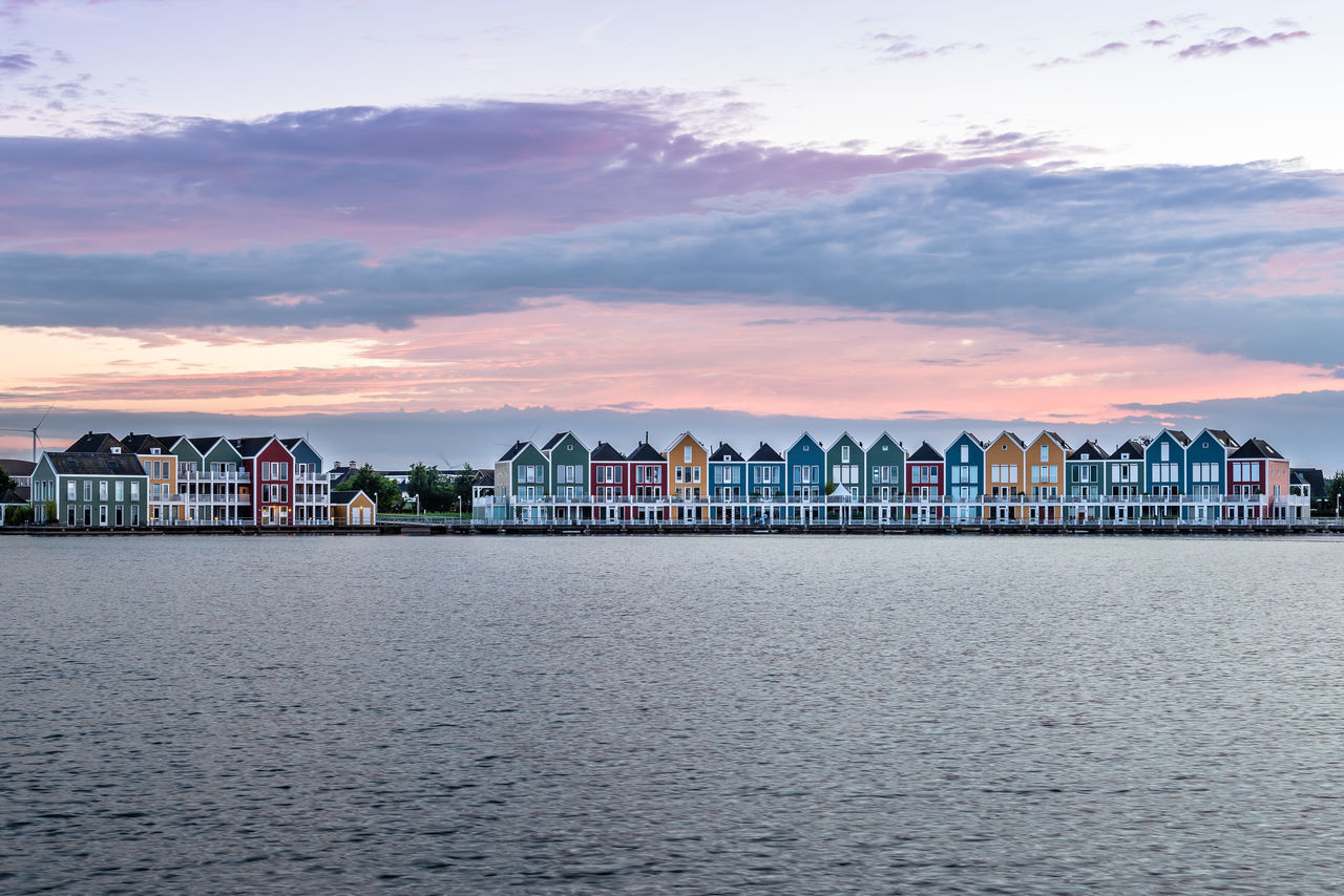 Colorful houses on waterfront Architecture Beauty In Nature Building Exterior Built Structure City Cloud - Sky Day Housing Housing Development Mountain Nature No People Outdoors Pond Real Estate Scenics Sea Sky Sunset Sunset_collection Water Waterfront