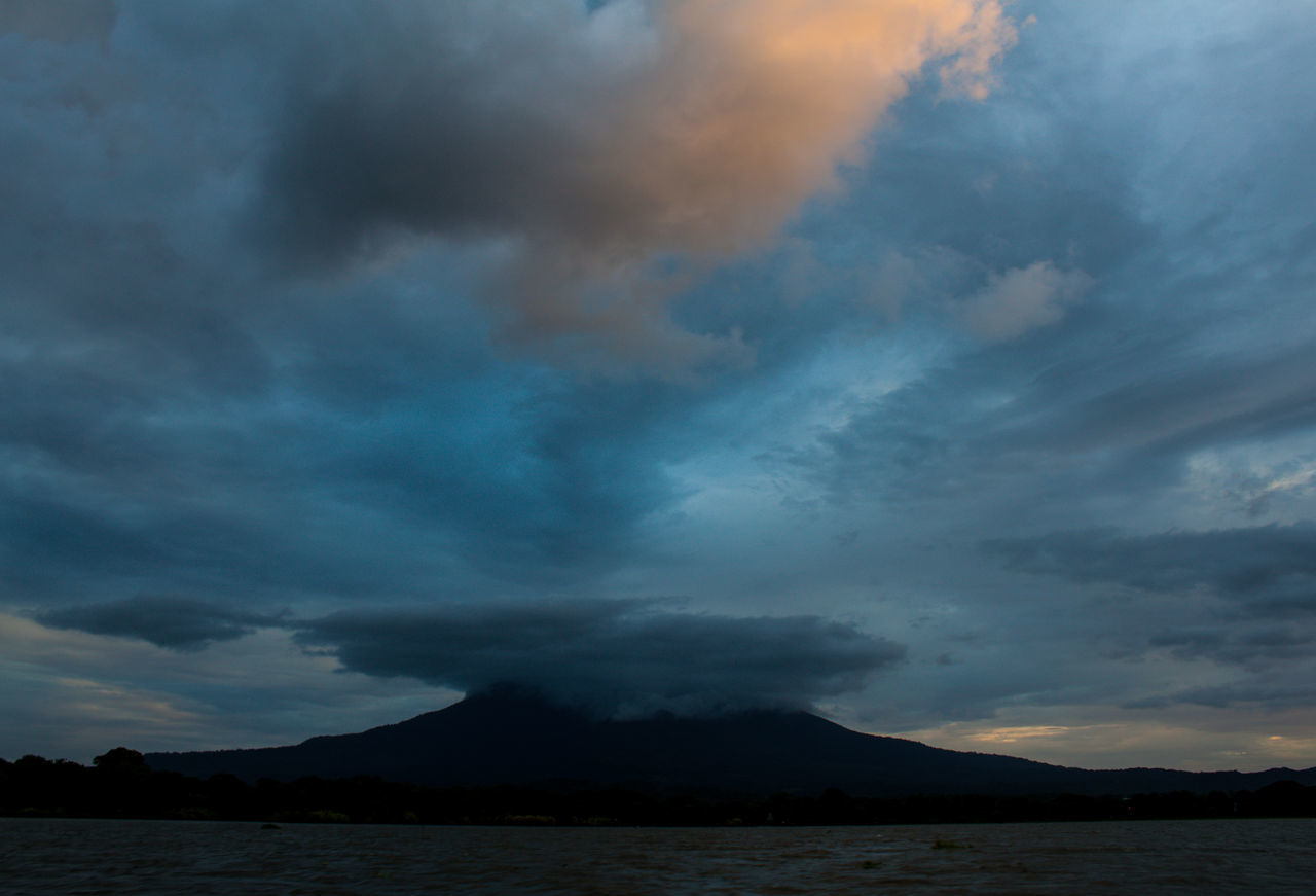 Beauty In Nature Boat Ride Cloud - Sky Cloudy Mountain Peaks Cloudy Mountain Top Day Gloomy Sky Gloomy Weather Granada, Nicaragua Landscape Mountain Mountain Peak Mountains And Sky Nature No People Outdoors Scenics Sky Storm Cloud Tranquil Scene Travel Water
