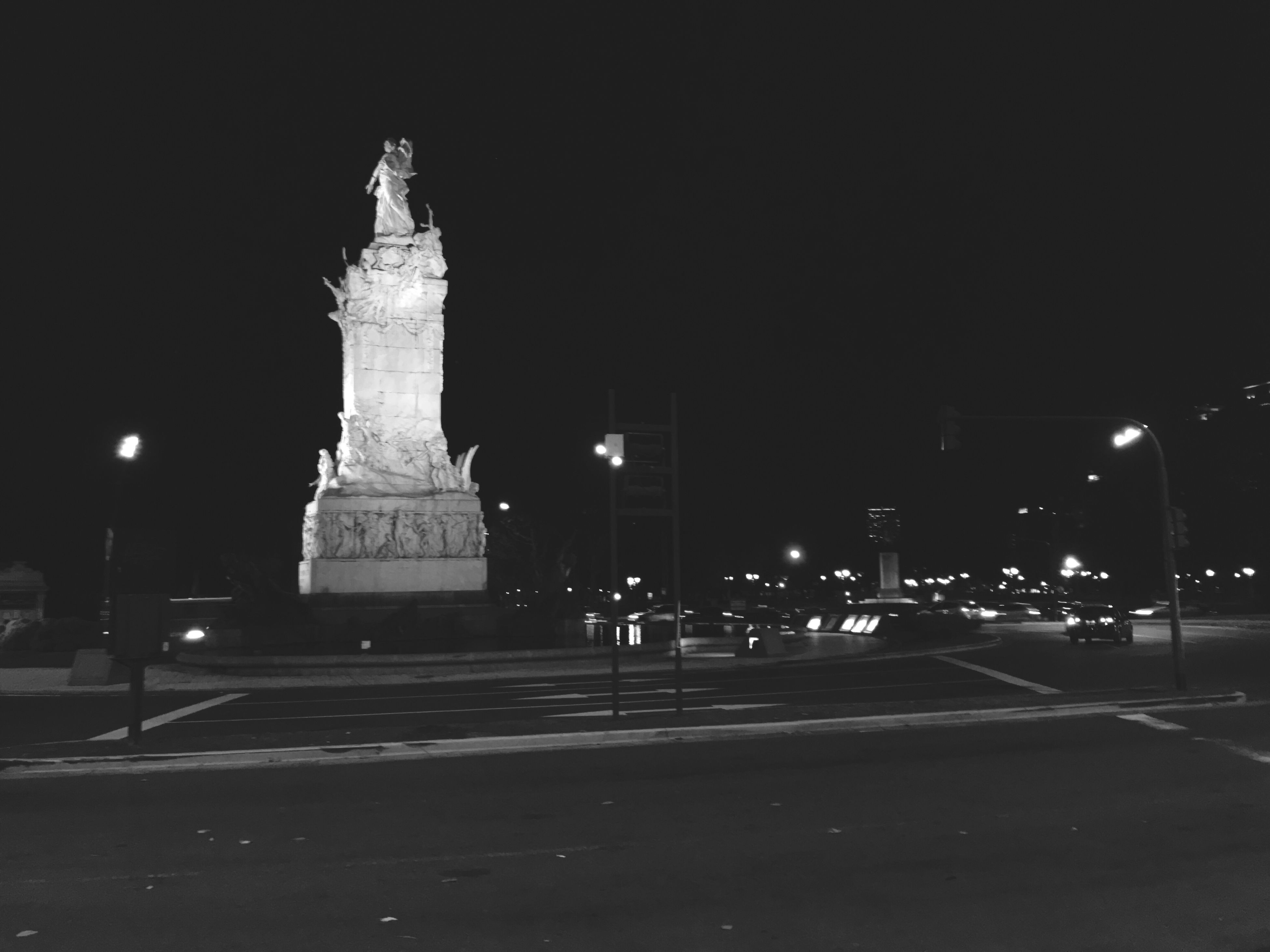 night, illuminated, building exterior, architecture, built structure, transportation, street, road, street light, car, clear sky, city, famous place, travel, statue, travel destinations, sky, history, copy space, sculpture