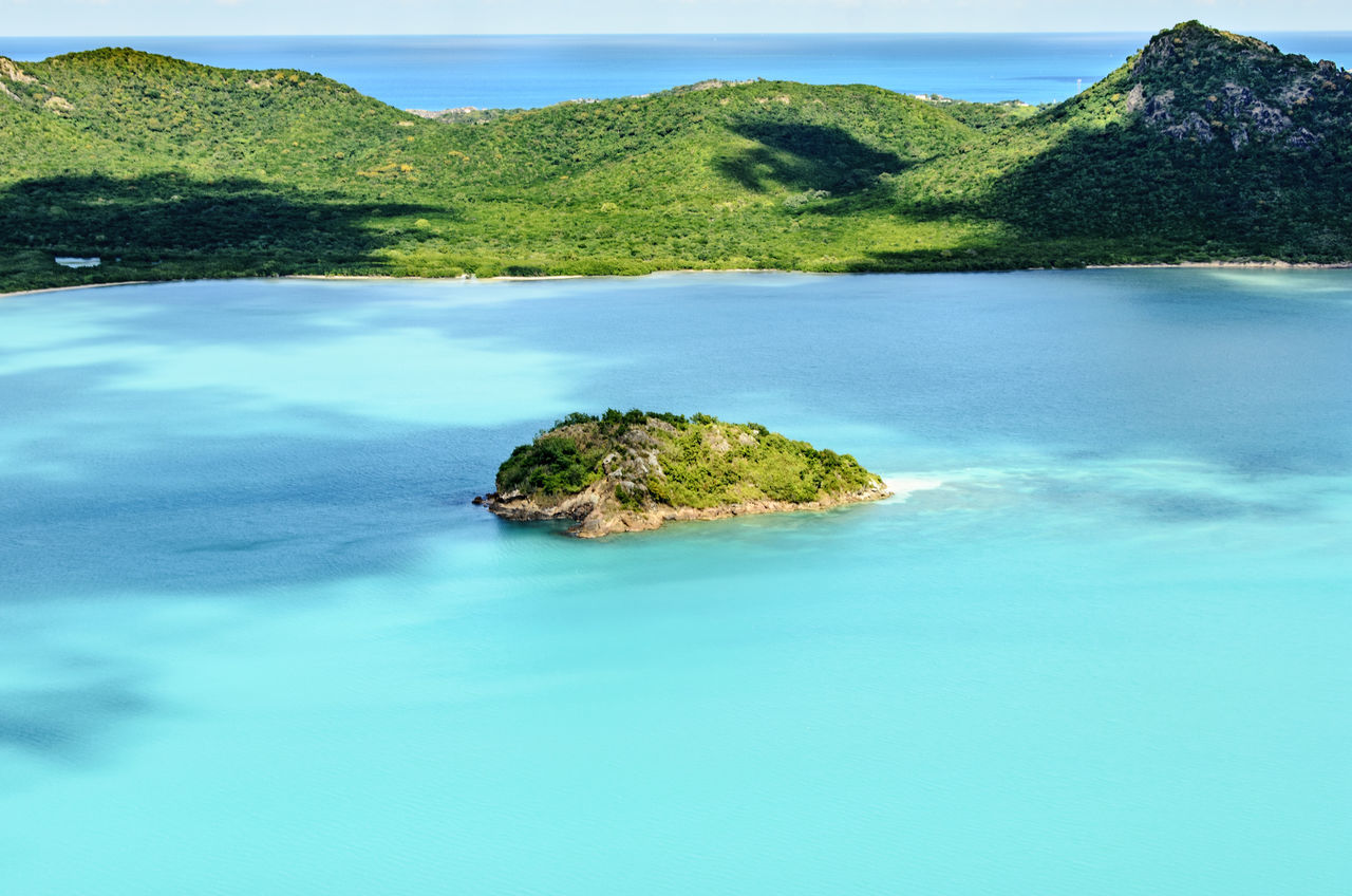 An aerial view of a tiny island within Antigua. Antigua Blue Caribbean Cliff Coastline Colors EyeEm EyeEm Best Shots EyeEm Nature Lover Hanging Out High Angle View Horizon Over Water No People Outdoors Relaxing Rock Rock Formation Scenics Sea Showcase: December Taking Photos Tranquil Scene Travel Traveling Water