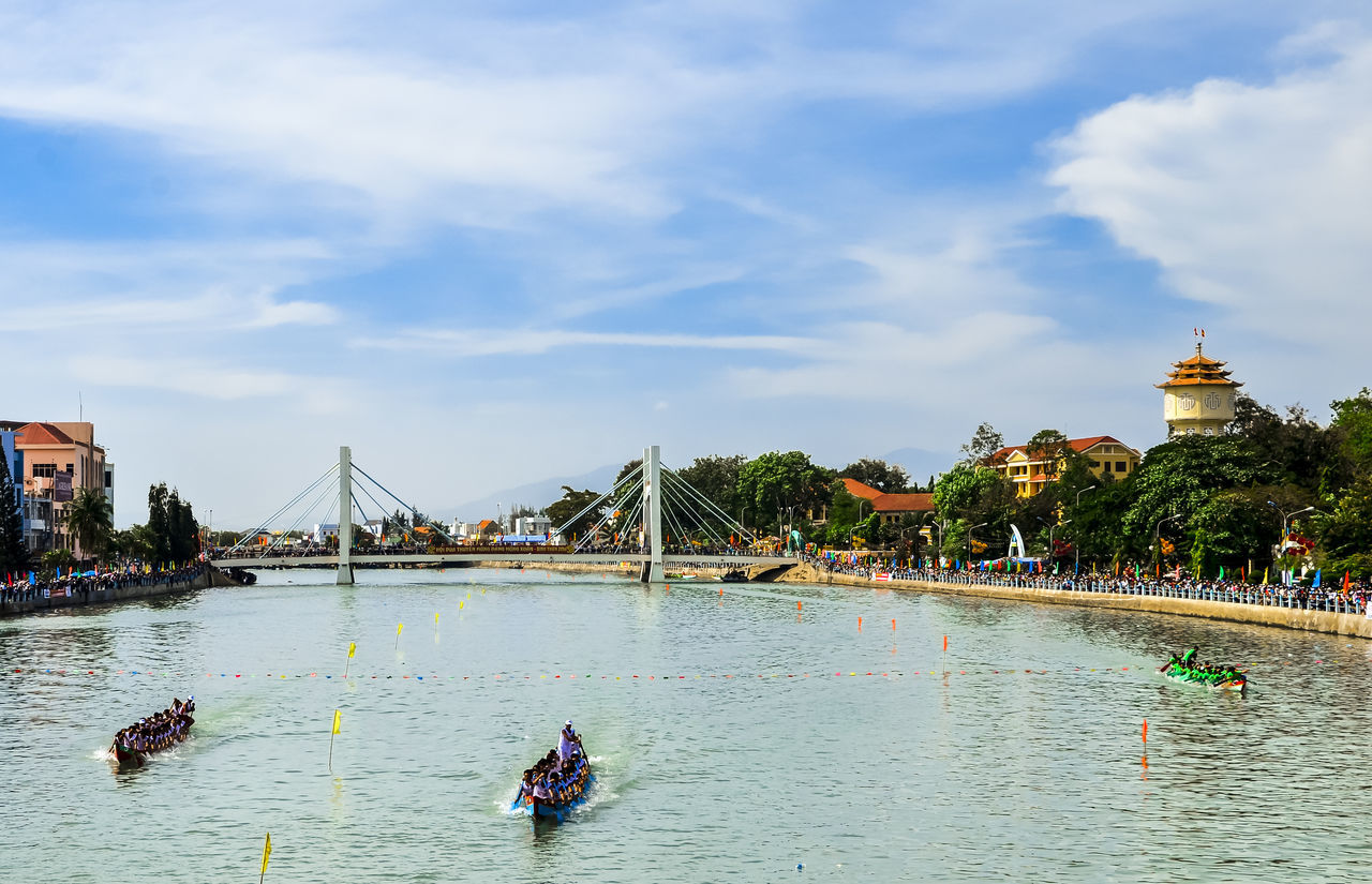 Spring boat racing in Ca Ty river Architecture Built Structure Ca Ty River Canal City City Life Cloud Cloud - Sky Cloudy Day Leisure Activity Lifestyles Mixed Age Range Nature Outdoors Phan Thiet River Sky Tourism Tourist Travel Destinations Tree Vacations Water
