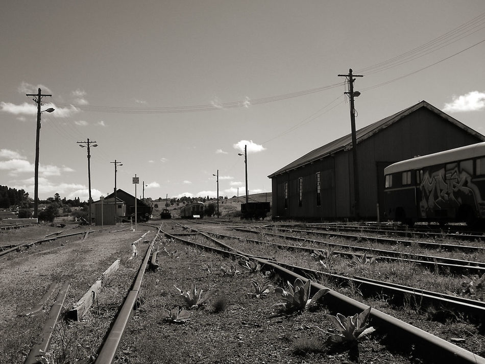 Architecture Austraila Black And White Photography Building Exterior Built Structure Cooma Day Electricity  Electricity Pylon End Of The Line Going Nowhere Mode Of Transport No People Outdoors Power Supply Powerline Rail Transportation Rail Yard Railroad Track Shunting Yard Sky Tracks Transportation