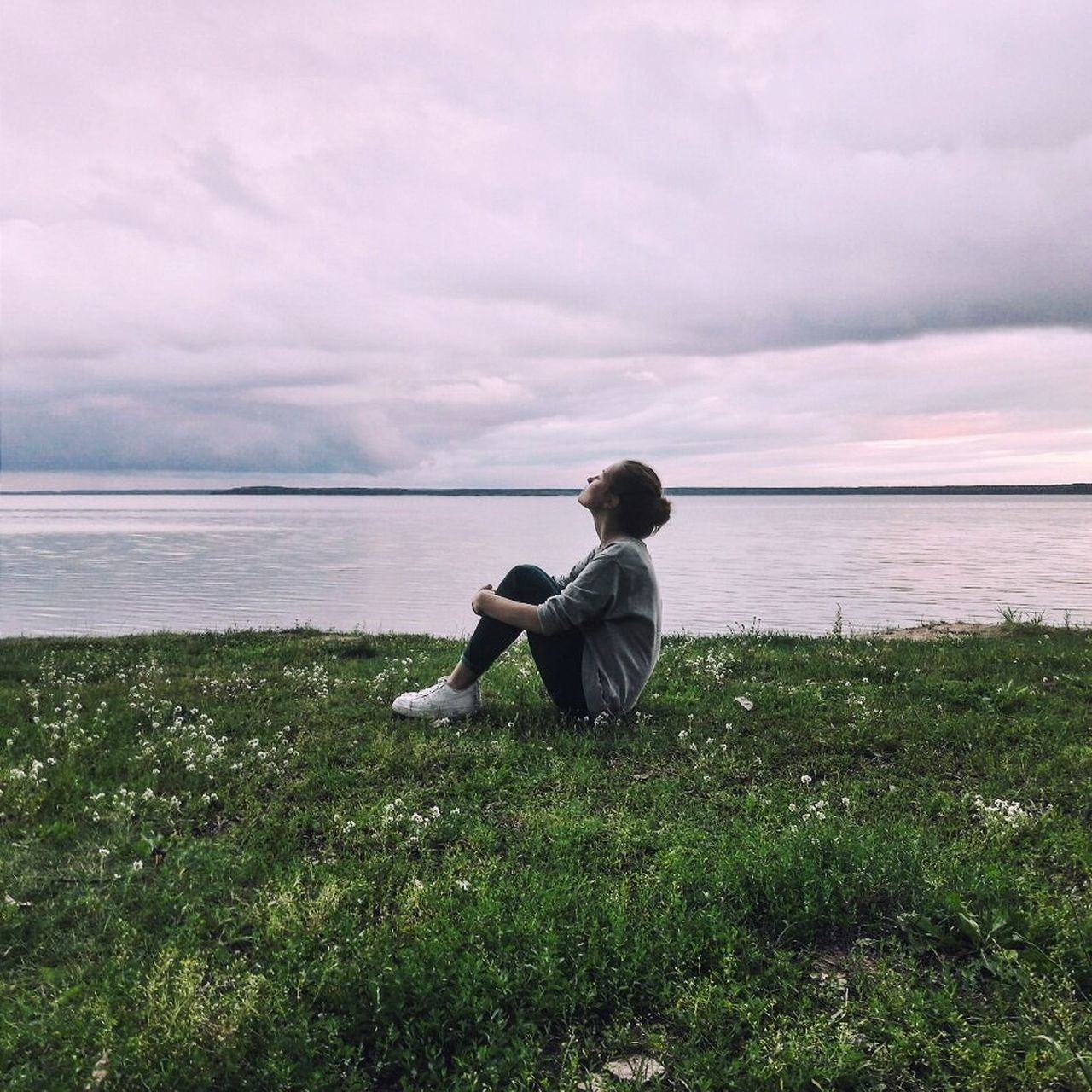 water, sea, horizon over water, nature, sky, scenics, tranquil scene, beauty in nature, tranquility, outdoors, one person, grass, fishing pole, day, cloud - sky, real people, full length, people
