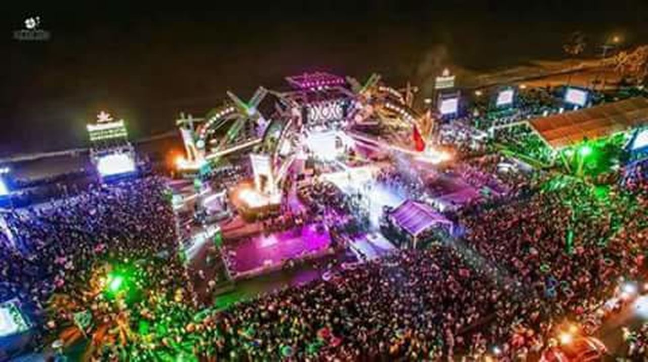 night, illuminated, crowd, large group of people, celebration, high angle view, performance, music, arts culture and entertainment, stage - performance space, outdoors, stage light, excitement, nightlife, popular music concert, stadium, people