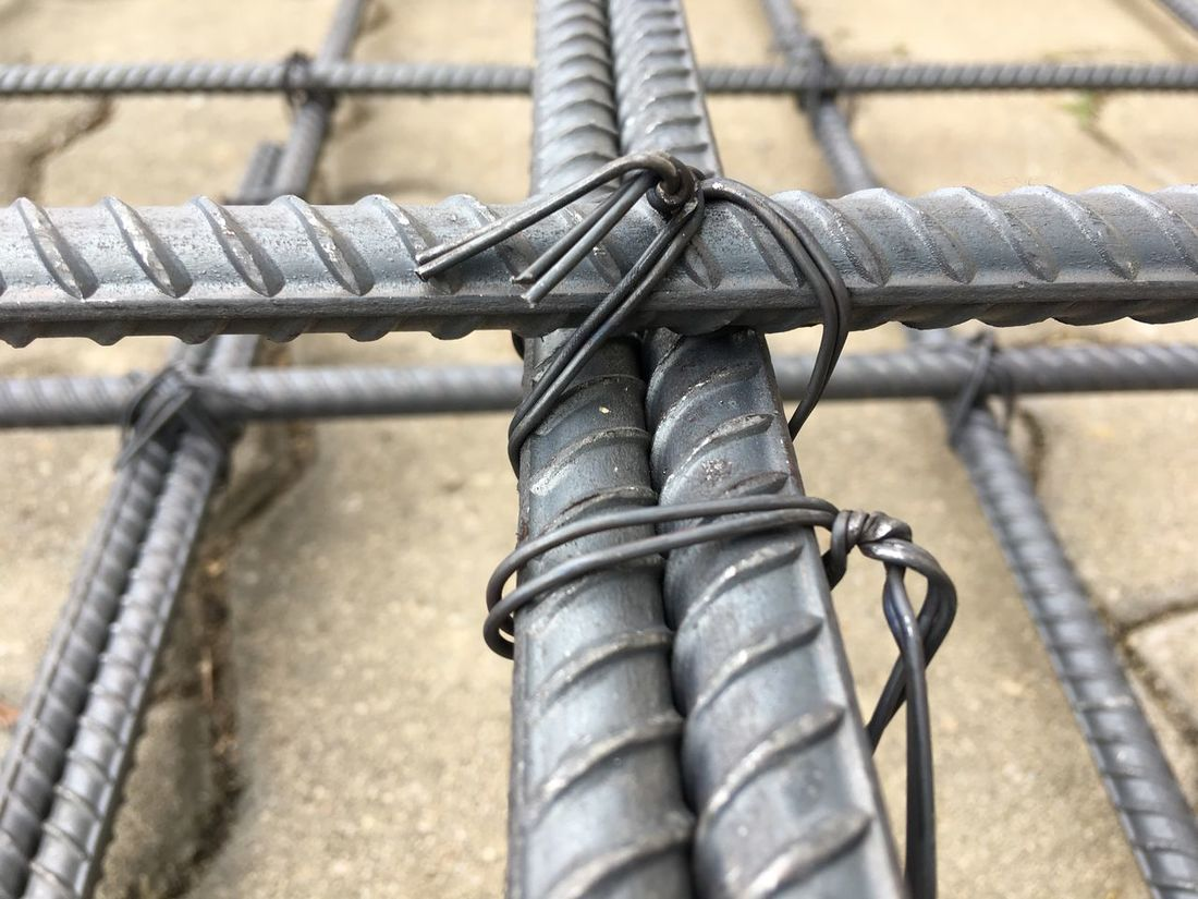 Close-up Focus On Foreground Metal No People Outdoors Day Connection Tied Up Attached Lock Structures Steel Works Bundle Fence