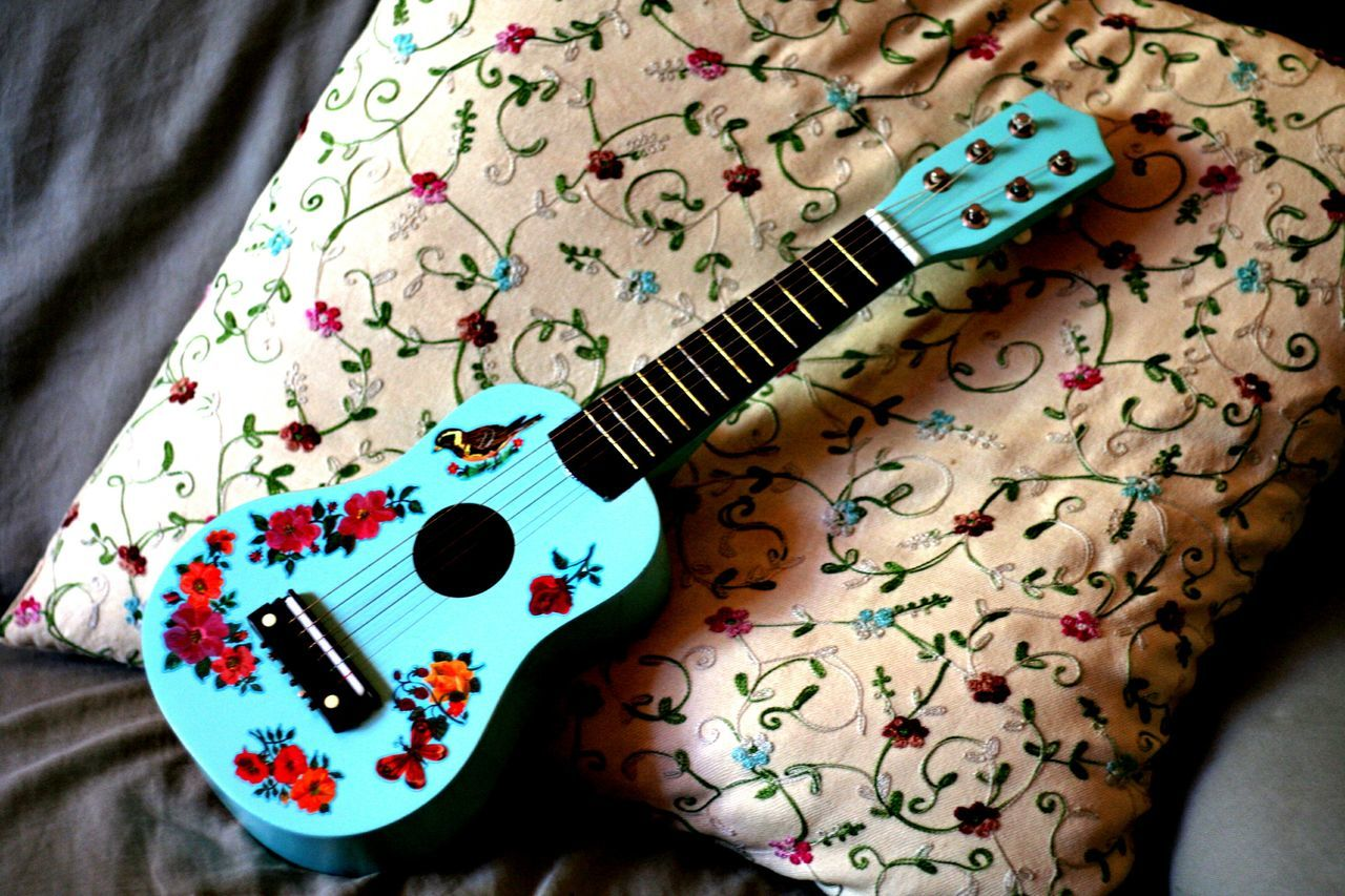 indoors, high angle view, guitar, table, multi colored, music, close-up, no people, musical instrument, day