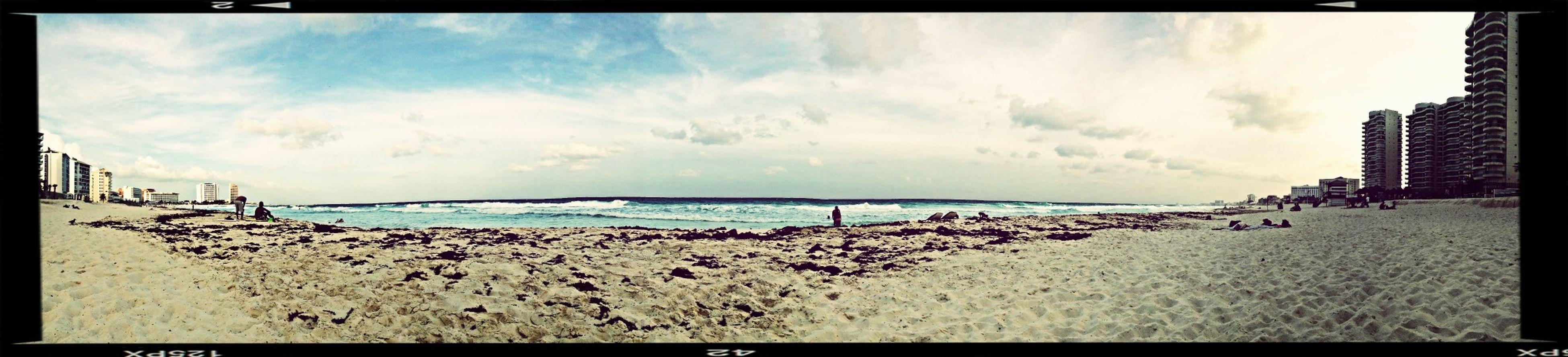 transfer print, sea, beach, sky, water, horizon over water, shore, auto post production filter, cloud - sky, panoramic, sand, scenics, tranquil scene, beauty in nature, tranquility, cloudy, cloud, nature, incidental people, coastline