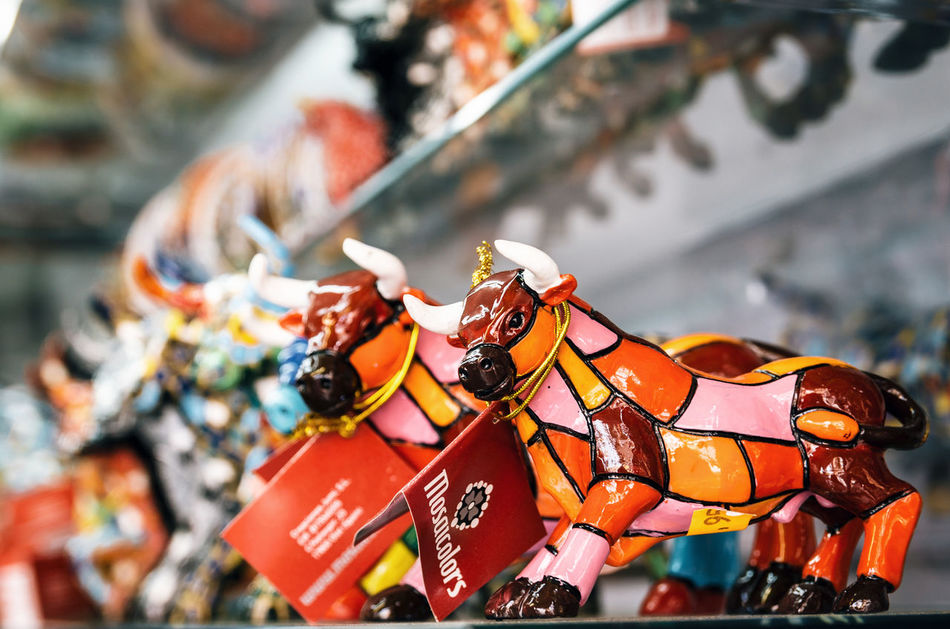 Multicolored mosaic figurine of bull in Gaudi style. Spanish traditional gifts in the souvenir shop. Barcelona Bull Close-up Colorful Cow Focus On Foreground Gaudi Gifts Mosaic Multi Colored Souvenir Souvenirs Tradition Traditional Traditional Culture