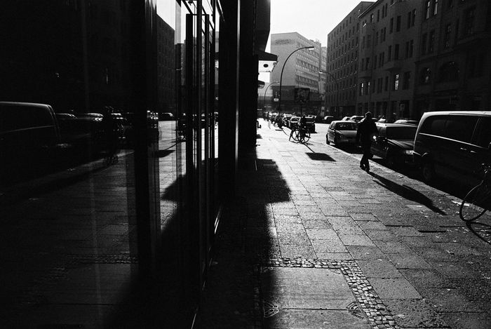 Analogue Photography Backlight NIKON F100 Neopan400 Reflection Shadows & Light Sunlight Architecture Blackandwhite Building Exterior Car City Day Land Vehicle Light And Shadow Monochrome Outdoors People Road Schwarzweiß Shadow Street Streetphotography Sunlight And Shadow Black And White Friday