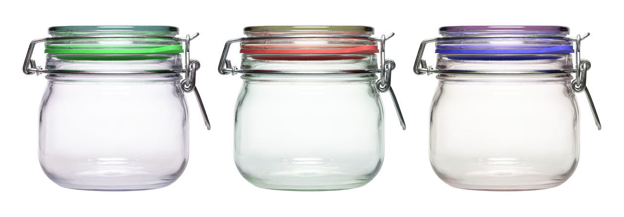 Panoramic Shot Of Empty Jars Against White Background