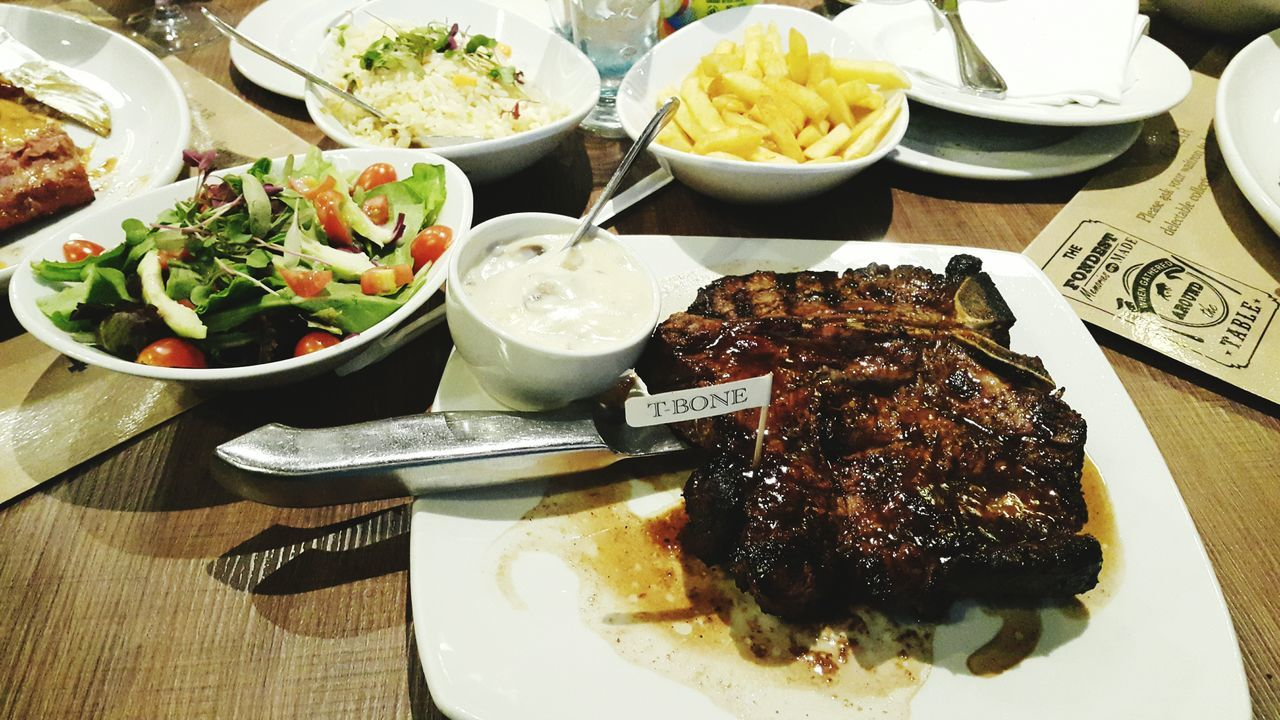 food, food and drink, plate, ready-to-eat, salad, freshness, table, serving size, high angle view, indoors, fork, healthy eating, bowl, no people, indulgence, meat, meal, close-up, rib, day