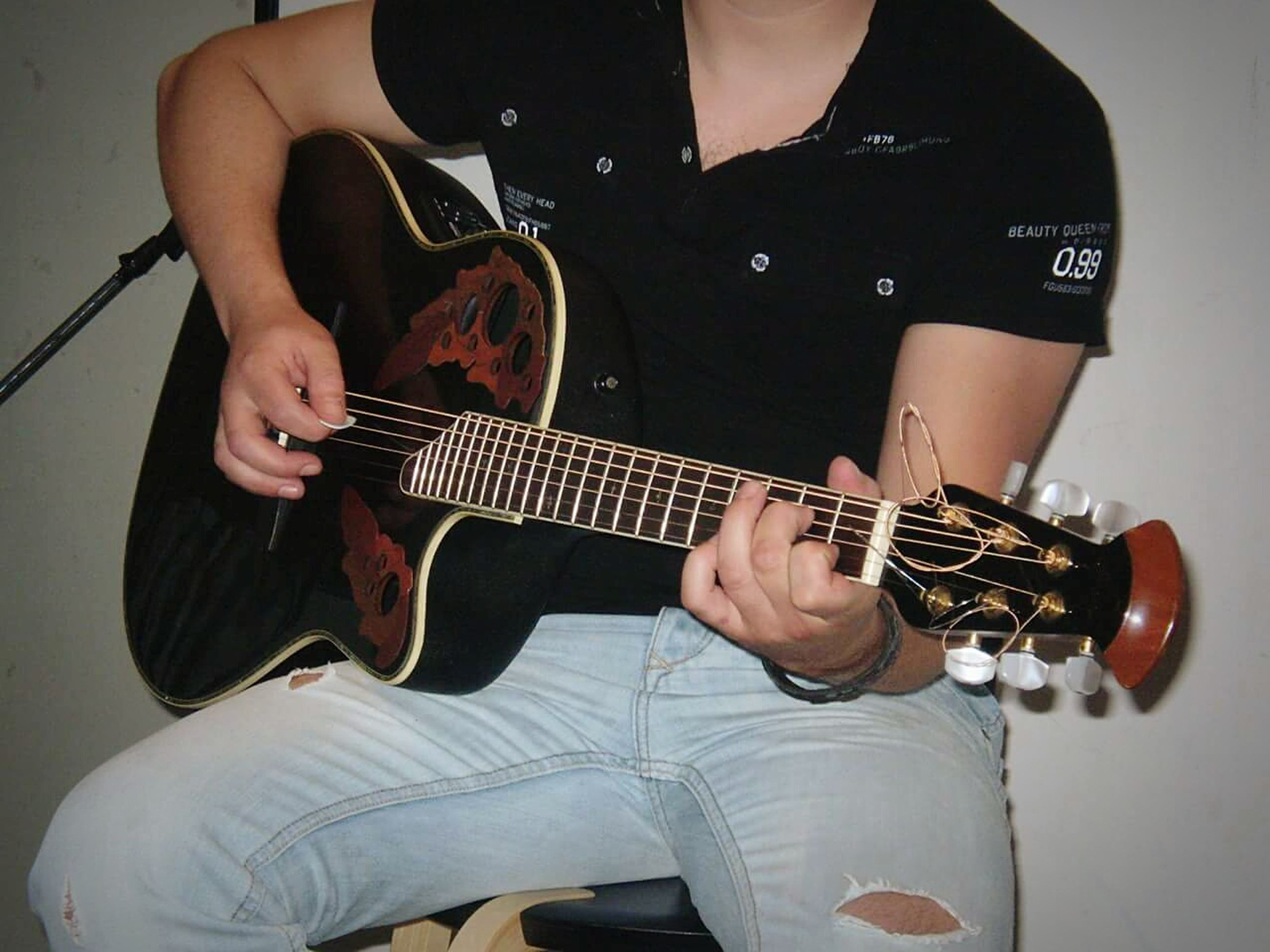indoors, music, holding, musical instrument, technology, arts culture and entertainment, wireless technology, lifestyles, guitar, person, connection, leisure activity, musical equipment, playing, photography themes, smart phone, communication, mobile phone