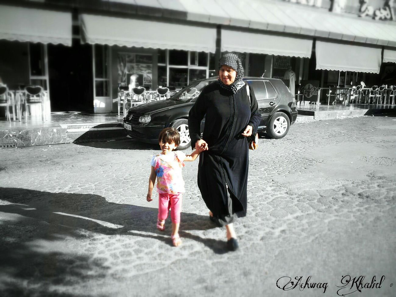 My mom with a little fella Streetphotography Blackandwhite Monochrome Picsart #Androidography #Androidphotography #ColorSplash #Mobilephotography #Phoneography #MobileOnly #N7000 #CameraFV5