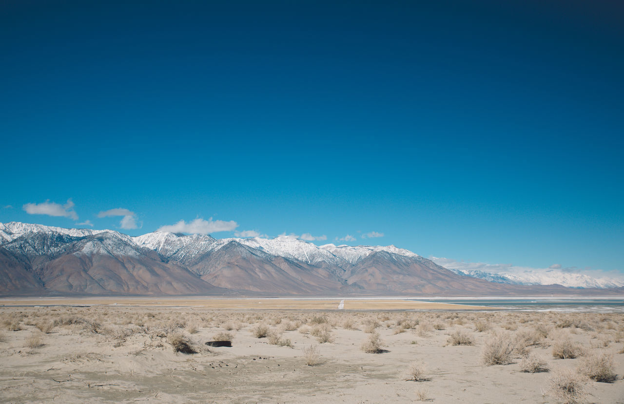 Arid Climate Arid Landscape Barren Beauty In Nature Blue Blue Sky CA-190 California Death Valley Desert Desert Landscape Mountain Mountain Range Nature Outdoors Physical Geography Road Roadtrip Salt - Mineral Salt Flat Sand Scenics Tranquil Scene Tranquility