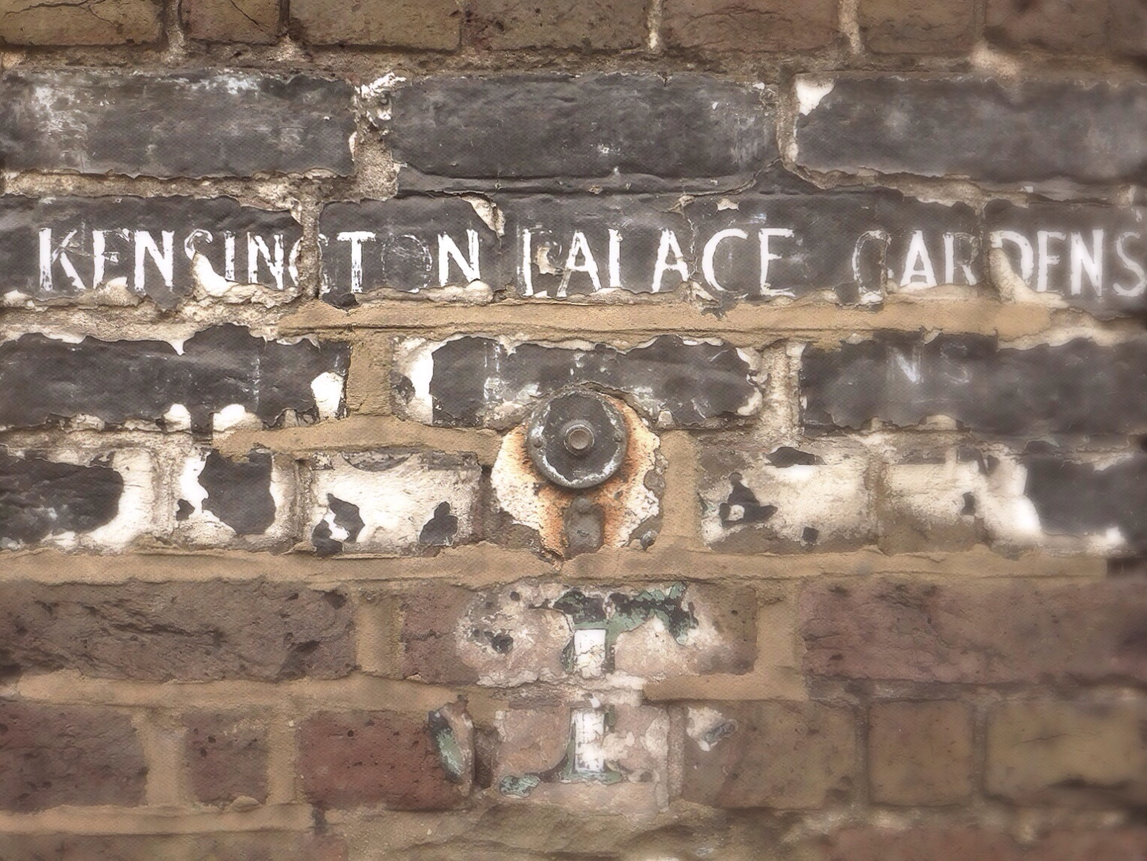 text, western script, communication, wall - building feature, non-western script, capital letter, architecture, built structure, close-up, old, wall, information, number, outdoors, day, no people, sign, history, building exterior, information sign