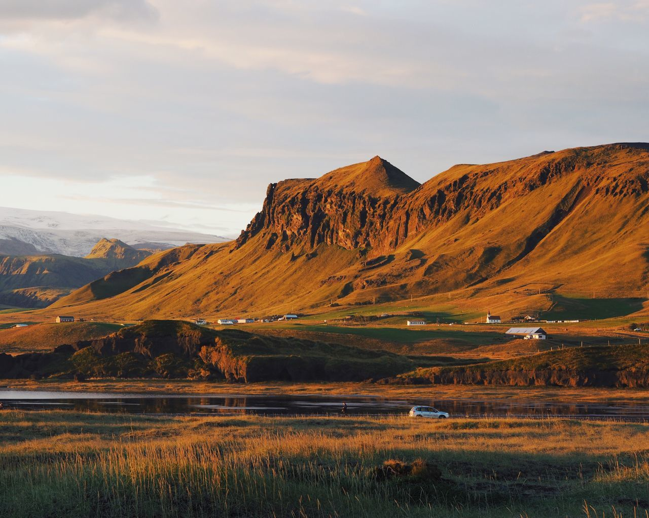 Mountain Mountain Range Beauty In Nature Scenics Landscape Nature Reflection Lake Outdoors Tranquil Scene Grass Sky Sunset Beautiful Light Miles Away in Iceland