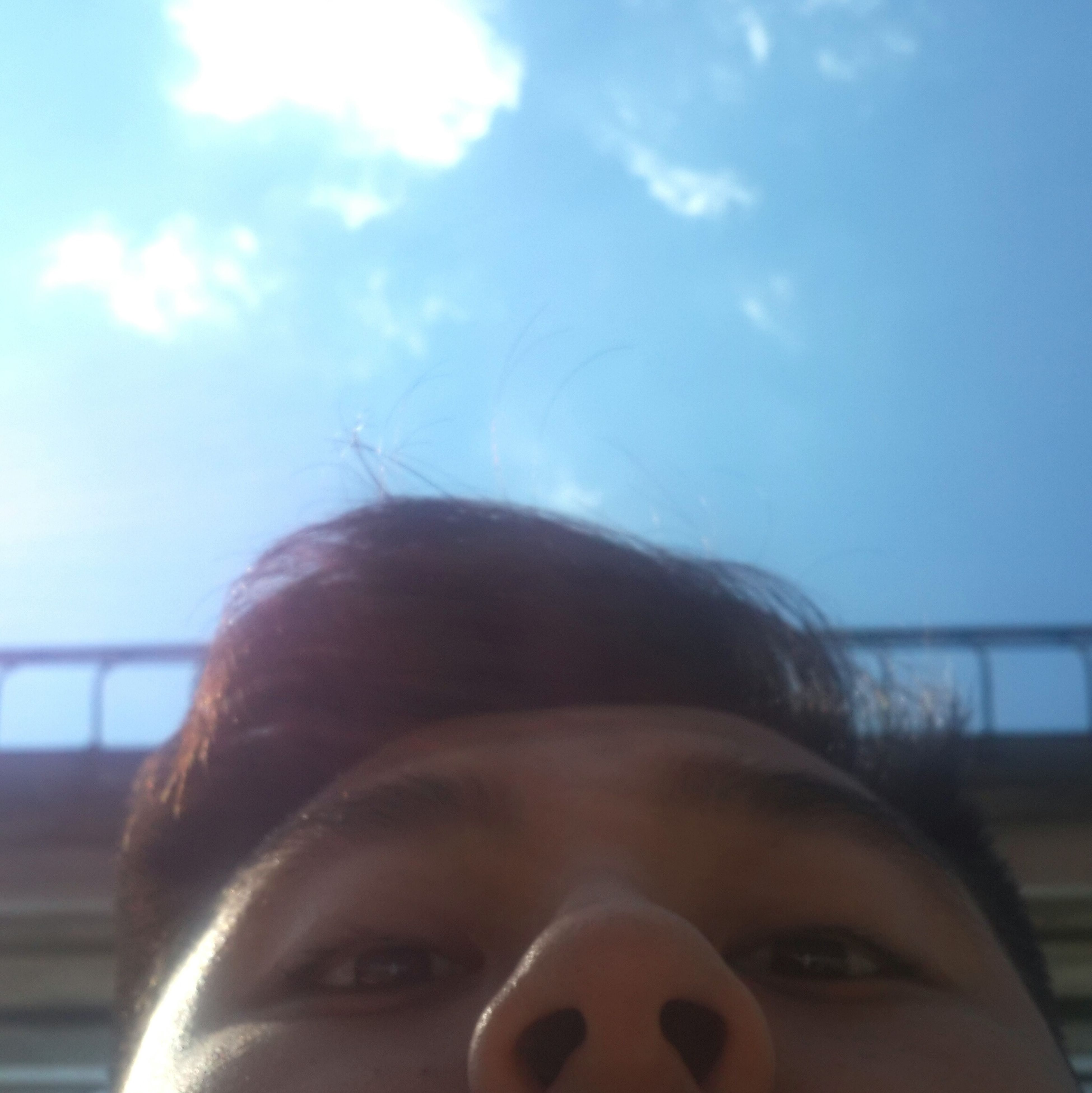 headshot, lifestyles, sky, close-up, leisure activity, head and shoulders, focus on foreground, person, human face, sunlight, sunglasses, young adult, portrait, day, looking at camera, low angle view, outdoors, front view
