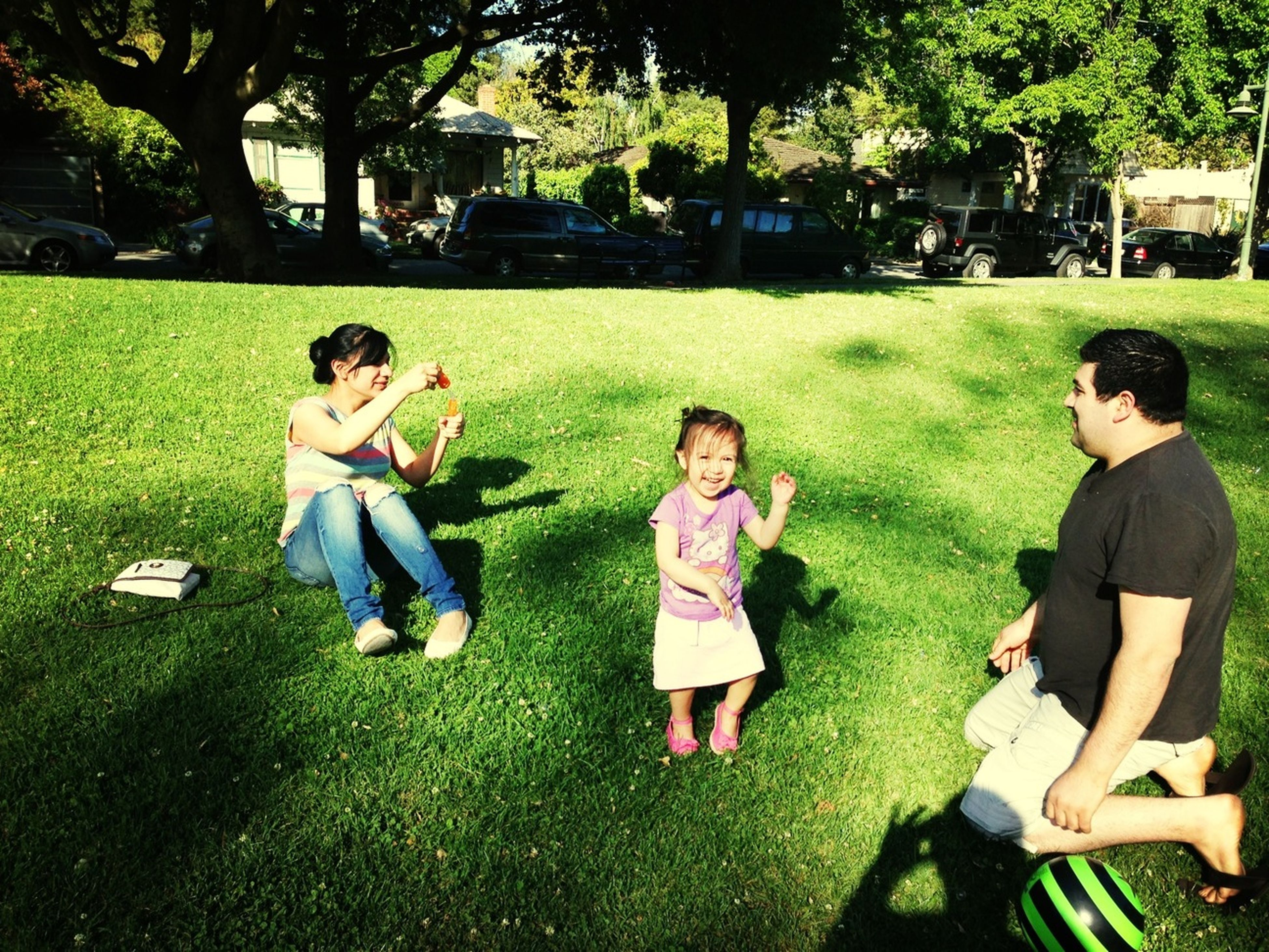 lifestyles, leisure activity, grass, togetherness, bonding, casual clothing, tree, sitting, park - man made space, love, person, friendship, green color, family, young men, boys, lawn, park