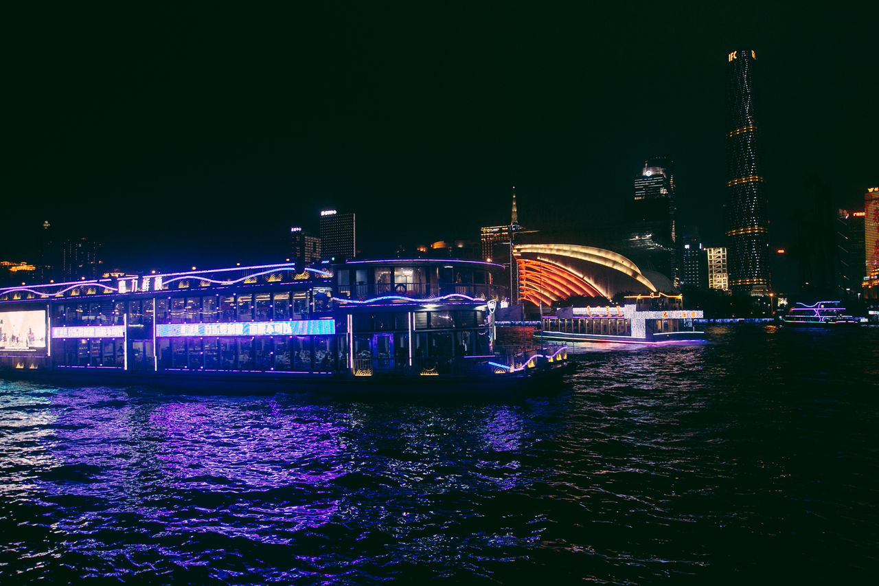 Falling in love with This city GuangZhou.❤Night Illuminated City Architecture Travel Destinations Water Building Exterior Vacations Bridge - Man Made Structure Nightlife Sky Neon Outdoors Popular Music Concert Cityscape Midnight No People EyeEmNewHere Funny Moments Passing Through Wonderful View WonderfulJourney Cityscape Having A Good Time Having Fun :)