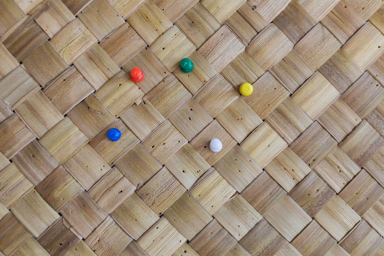 Push pins on bamboo board. Bamboo Colorful Day Green No People Office Office Supply Push Pins Red Thumb Tacks Wood - Material