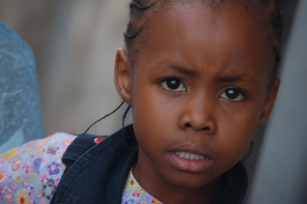 Close-Up Portrait Of Serious Girl
