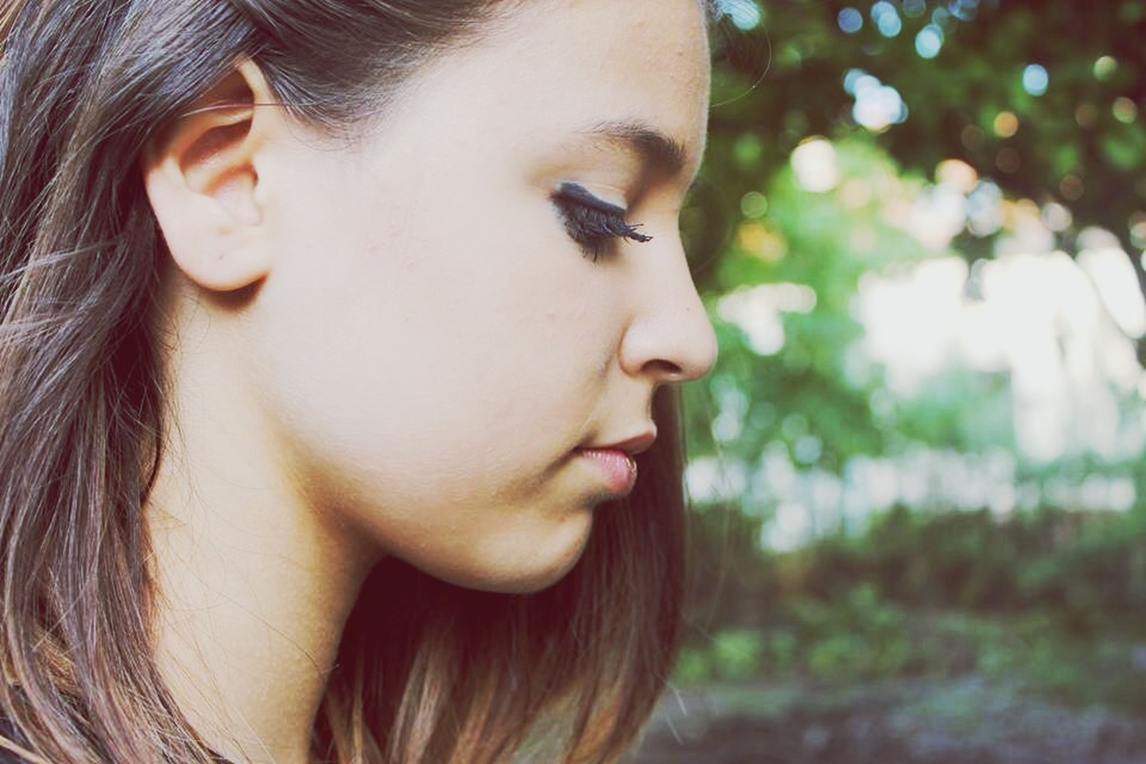 headshot, person, young women, young adult, close-up, long hair, looking at camera, portrait, lifestyles, focus on foreground, human face, front view, head and shoulders, leisure activity, contemplation, brown hair