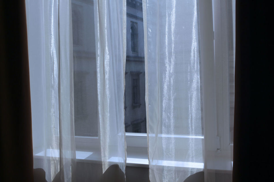 Through to the other side Architecture Built Structure Curtain Day Eye4photography  Glass Glass - Material Home Interior House Indoors  Looking Through Window No People Pattern Popular Photos Reflection Sunlight Taking Photos Textile The Other Side Through And Beyond Transparent Water White Color Window Window Sill