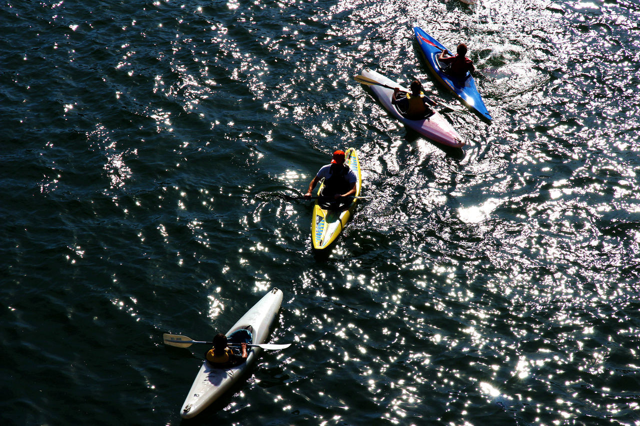 real people, high angle view, men, water, togetherness, day, teamwork, river, waterfront, oar, outdoors, rowing, competitive sport, nature, sport, lifestyles, sport rowing, group of people, nautical vessel, competition, athlete, sportsman, adult, people, adults only