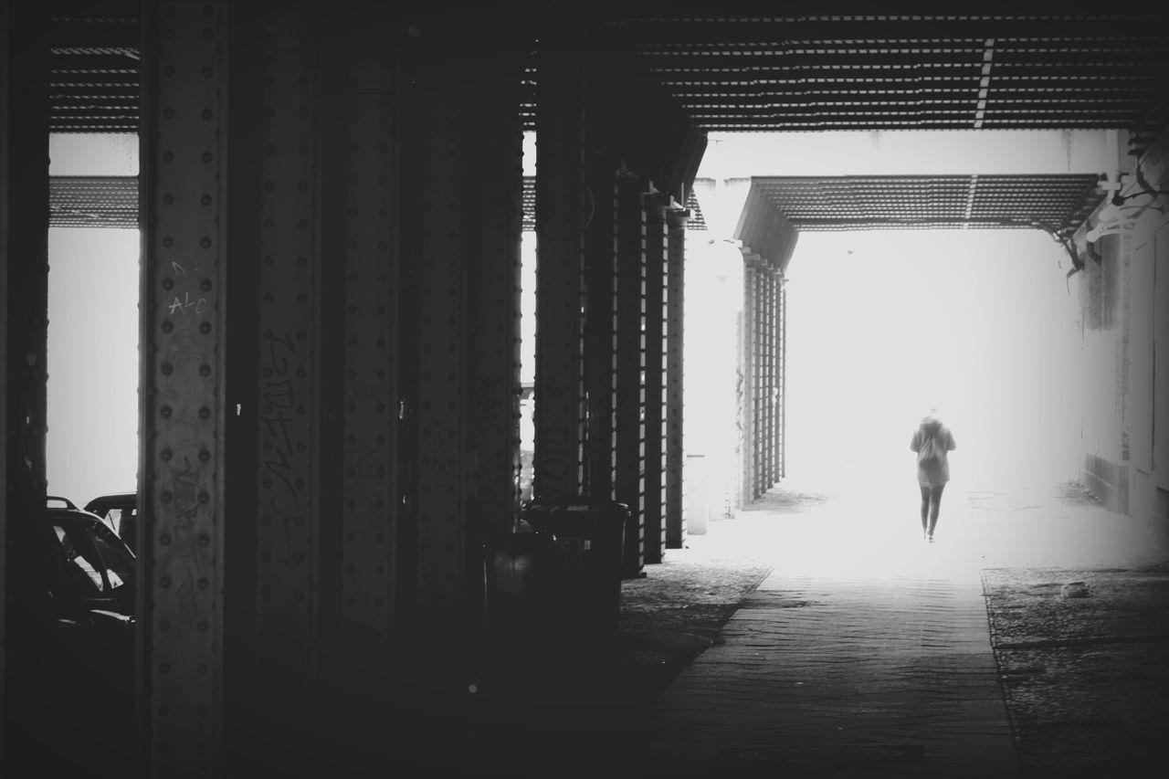 Silhouette Person Walking On Empty Road