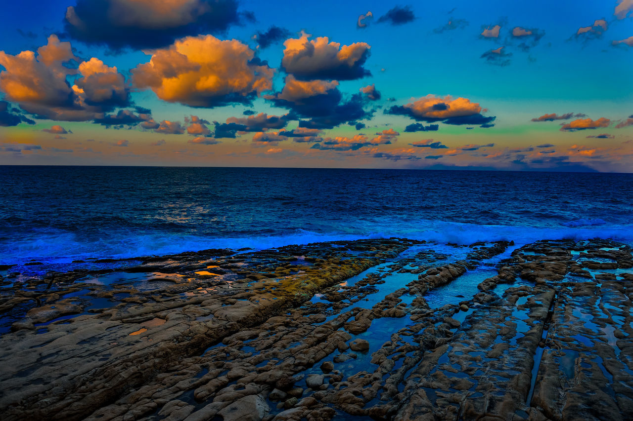 Beauty In Nature Cloud Clouds Clouds And Sky Horizon Over Water Idyllic Orange Color Outdoors Rock Formation Rocks Scenics Sea Sea And Sky Sea Life Sea View Sea_collection Seascape Seaside Sky Sky And Clouds Sky_collection Sky_collection Skyline Sunset Tranquil Scene