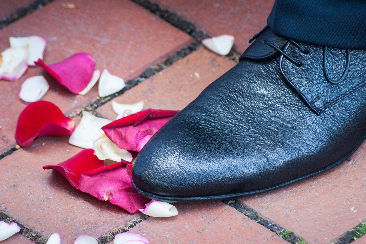Close-Up Of Groom In Black Shoe