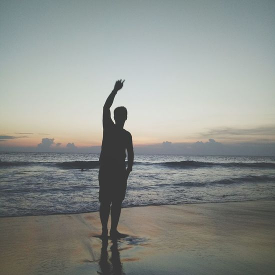 Sunset Beach Silhouette Adult Sea Mid Adult People Sky Standing Sun One Person Full Length Outdoors Reflection Adults Only Nature Tranquil Scene Tranquility Spirituality One Man Only