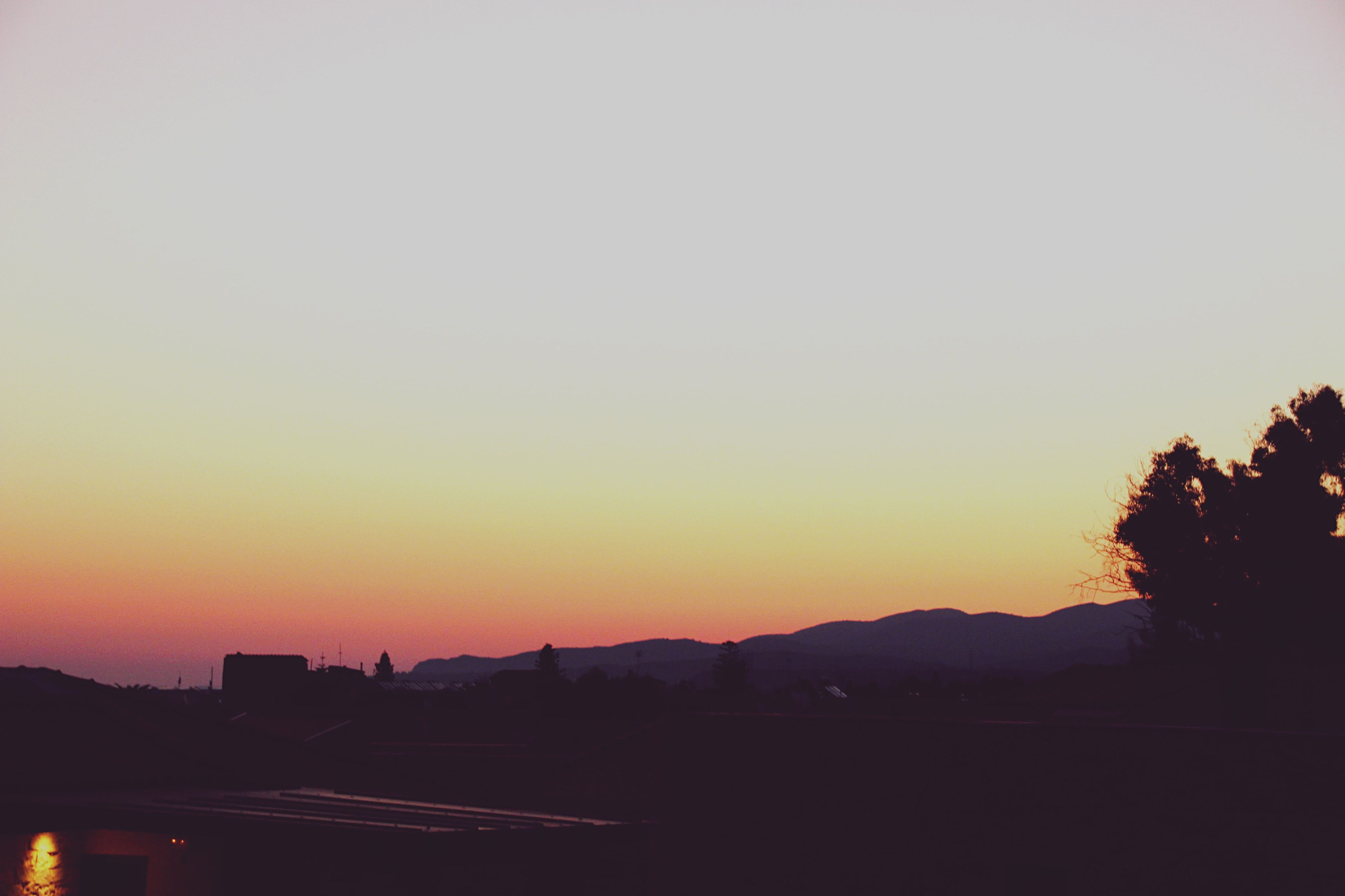 copy space, silhouette, clear sky, sunset, landscape, tranquil scene, tranquility, scenics, mountain, solitude, dark, beauty in nature, remote, outline, nature, outdoors, mountain range, calm, in front of, countryside, majestic, non-urban scene, no people, long, moody sky, country road