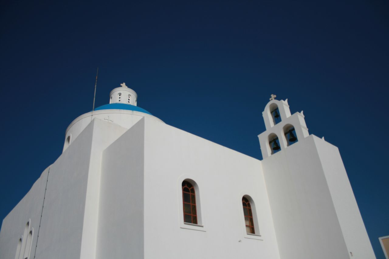 Churches of Santorini 🇬🇷 03 Religion Low Angle View Architecture Built Structure Building Exterior Place Of Worship Spirituality Clear Sky White Color Whitewashed Cross Day No People Outdoors Sky Bell Tower Santorini, Greece Churches Vacations Canonphotography Canon400d Cultures Nature