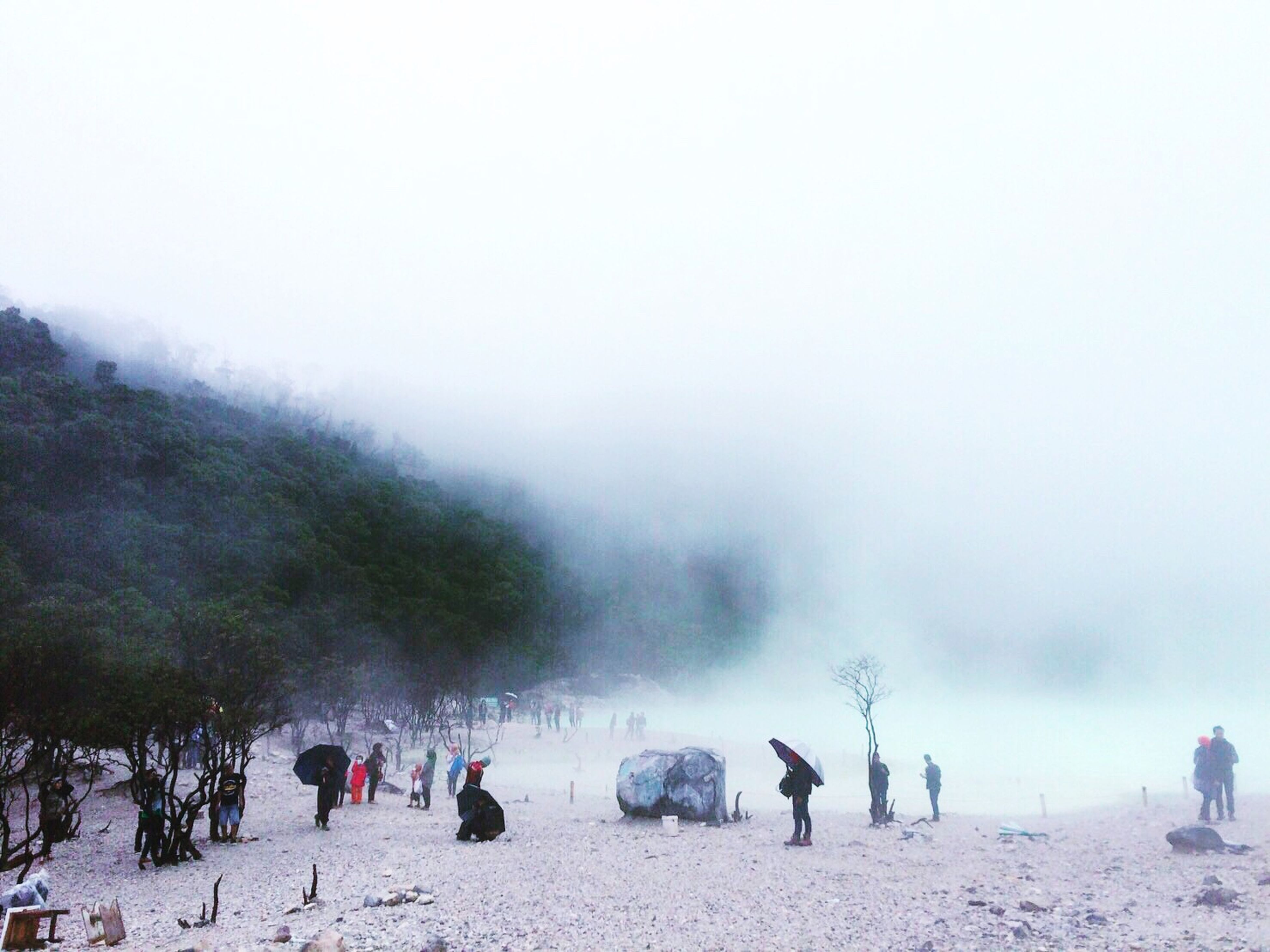 weather, lifestyles, fog, leisure activity, sky, season, scenics, nature, beauty in nature, vacations, landscape, tranquility, tranquil scene, mixed age range, tourism, foggy, day, overcast, non-urban scene, tourist, outdoors, travel destinations, mountain, idyllic, cloud - sky