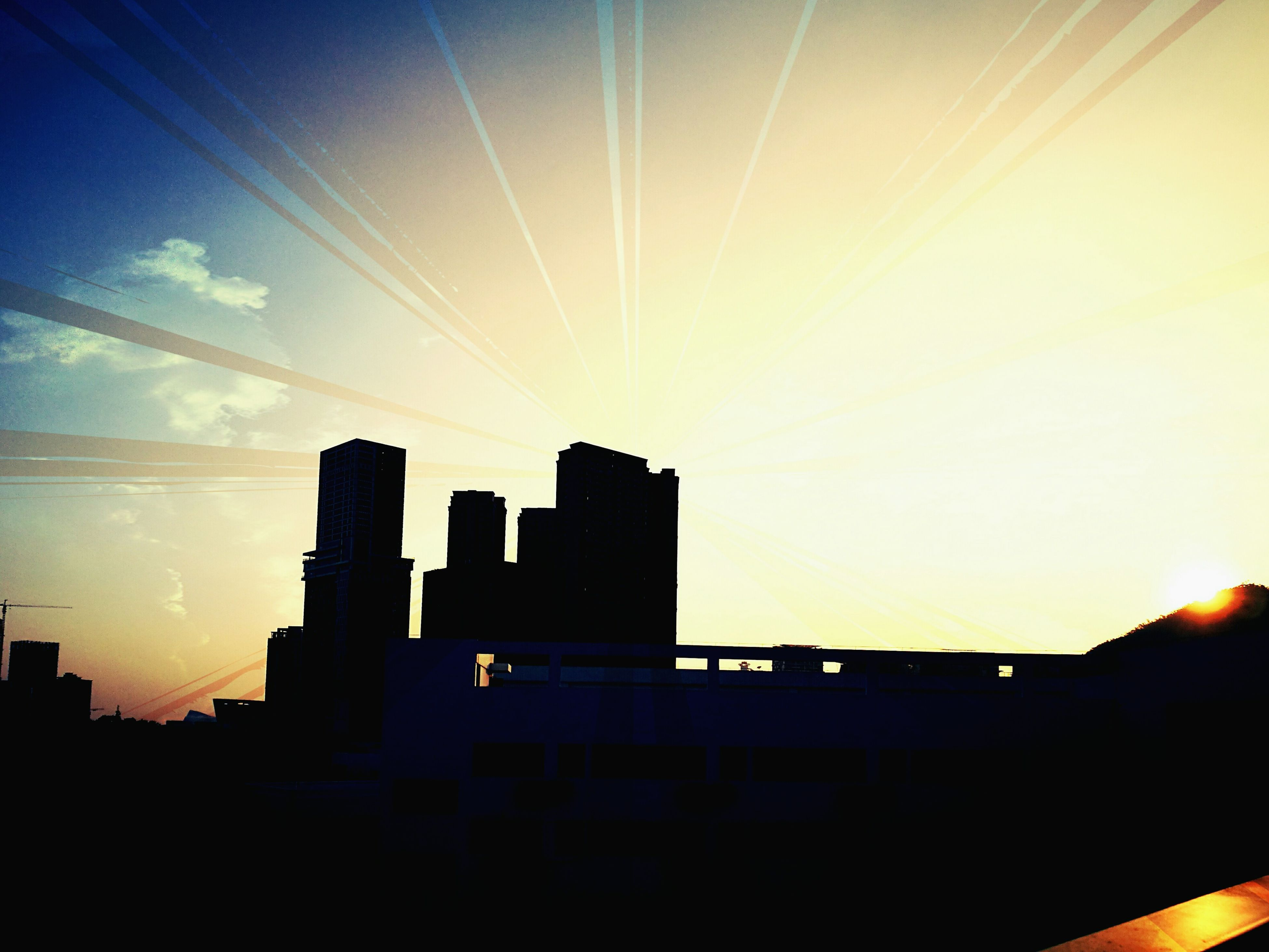 sky, building exterior, no people, sunset, built structure, silhouette, city, architecture, outdoors, skyscraper, day