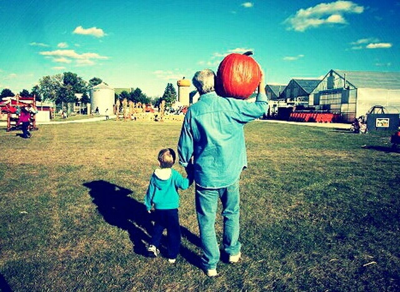 Father and son on a farm carrying a pumpkin Colorphotography Kids Being Kids Color Portrait Color Photography Fall Autumn Pumpkin Pumpkins Father & Son Father And Son Fatherhood  Dad And Son Farm Farm Life Pumpkin Patch Pumpkinpatch Fatherandson Daddy And Son Walking Hand In Hand Color Autumn Collection Fall_collection Fall Colors Colors