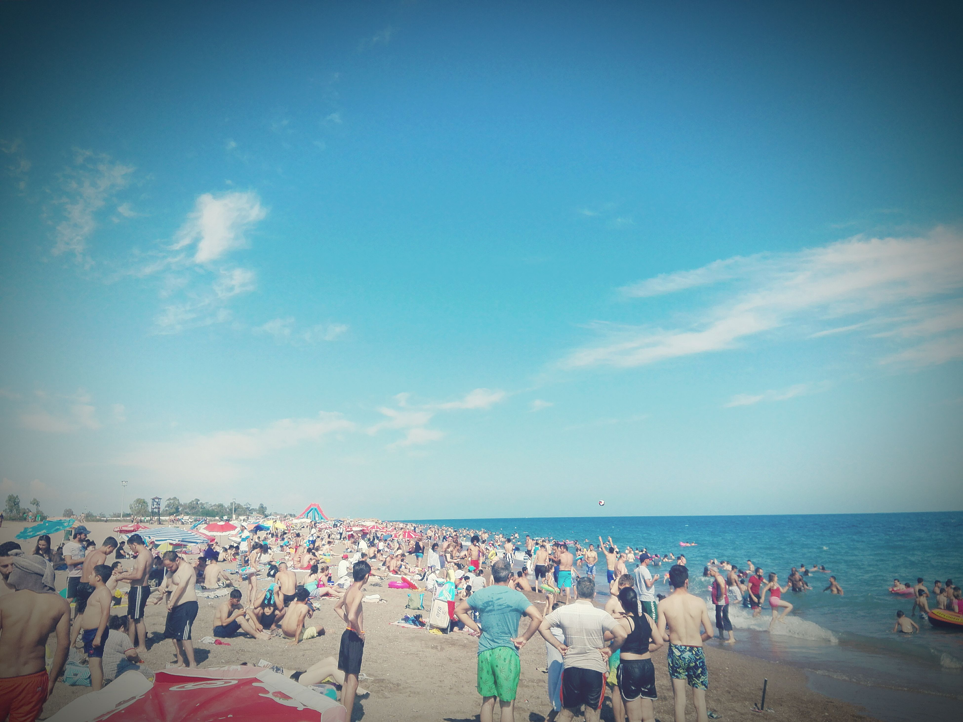 large group of people, beach, sky, sea, horizon over water, real people, sand, water, men, leisure activity, enjoyment, cloud - sky, lifestyles, women, vacations, nature, crowd, day, weekend activities, scenics, summer, outdoors, relaxation, beauty in nature, togetherness, people, adult