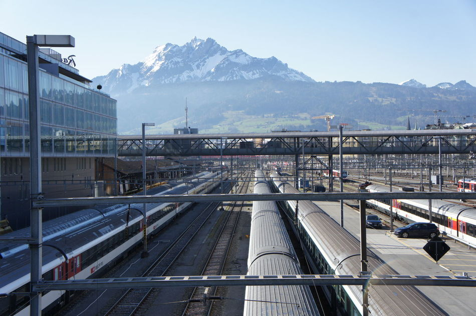 Architecture Built Structure Cold Temperature Day High Angle View Mountain Mountain Range Nature No People Outdoors Pilatus Public Transportation Rail Transportation Railroad Track Sky Snow Train - Vehicle Transportation Travel