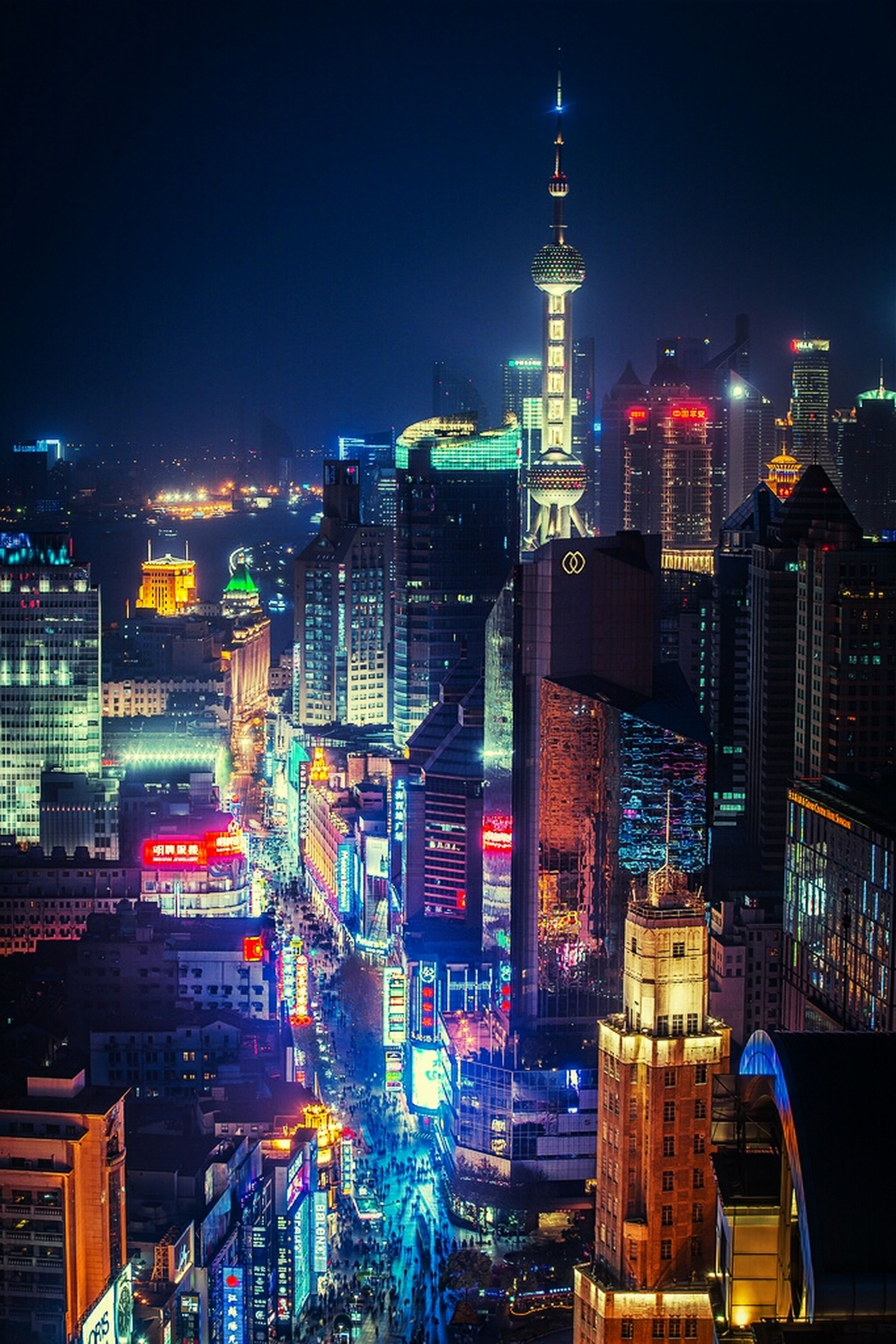 illuminated, night, city, architecture, building exterior, built structure, cityscape, skyscraper, tower, modern, tall - high, capital cities, office building, travel destinations, city life, famous place, financial district, high angle view, travel, crowded