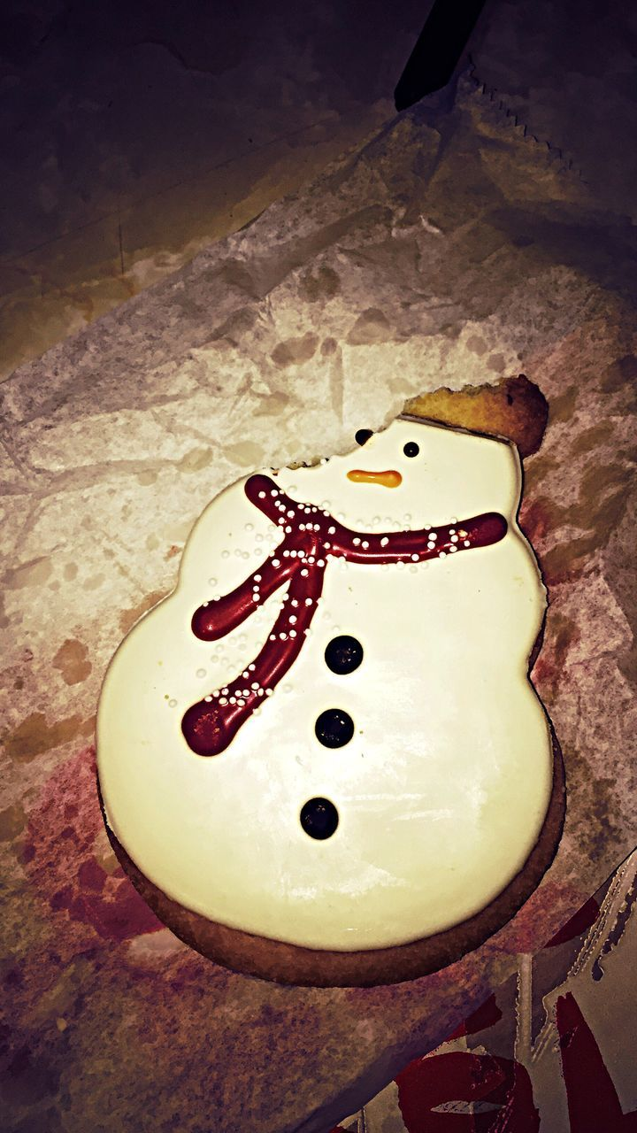 food and drink, indoors, food, no people, sweet food, high angle view, snowman, table, freshness, anthropomorphic face, unhealthy eating, close-up, ready-to-eat, day