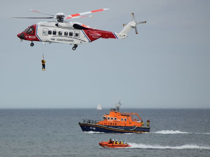 RNLI Open Day, August 2017. Withernsea lifeboat, Humber Lifeboat, RNLI Coastguard Rescue Helicopter Lifeboat RNLI Air Vehicle Boat Coastguard Day Flying Helicopter Horizon Over Water Lifeboat RNLI Mid-air Nature Nautical Vessel No People Outdoors Red Rescue Sea Sky Transportation Water Winchman