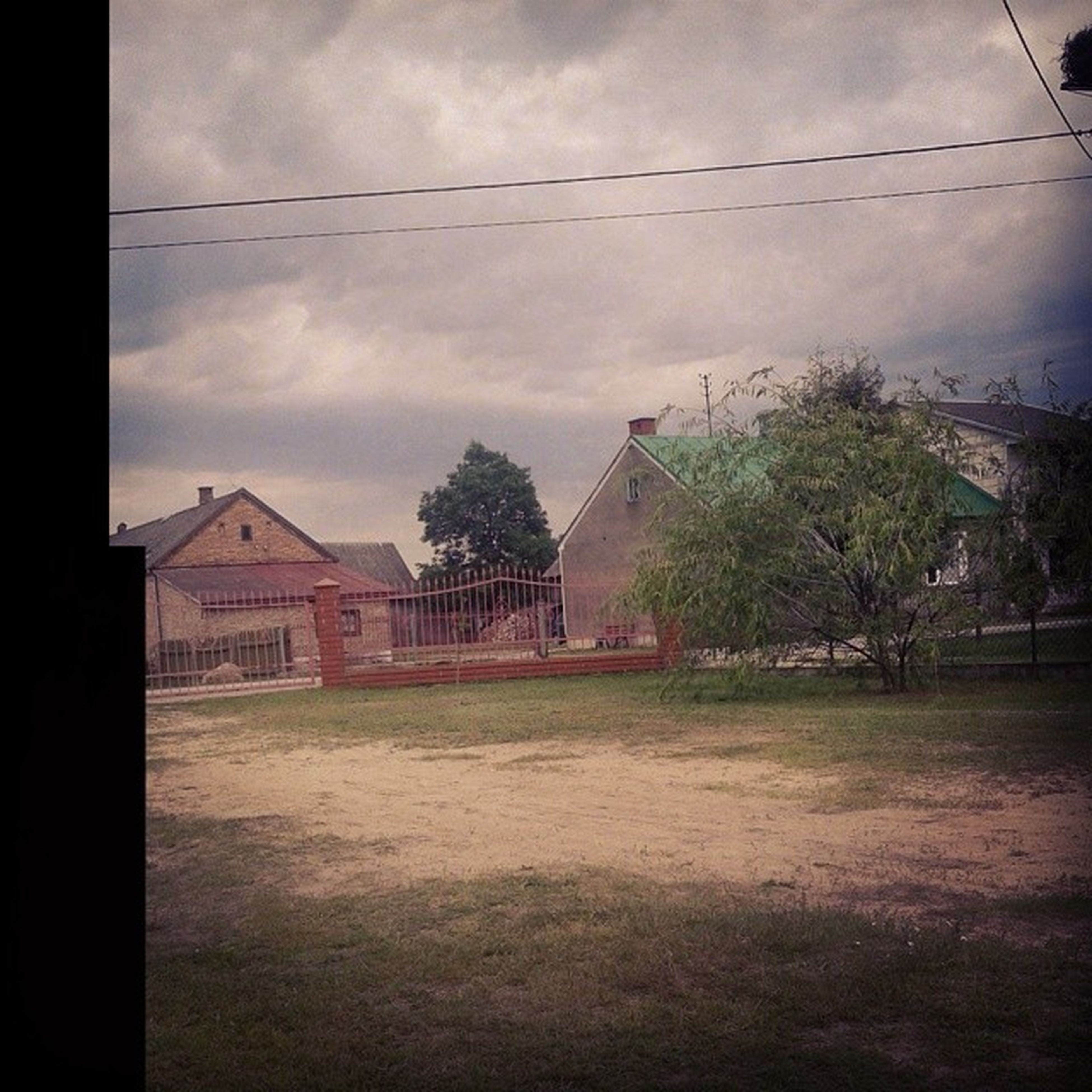 architecture, building exterior, built structure, sky, house, cloud - sky, tree, residential structure, cloud, cloudy, residential building, power line, electricity pylon, town, outdoors, nature, no people, day, landscape, building