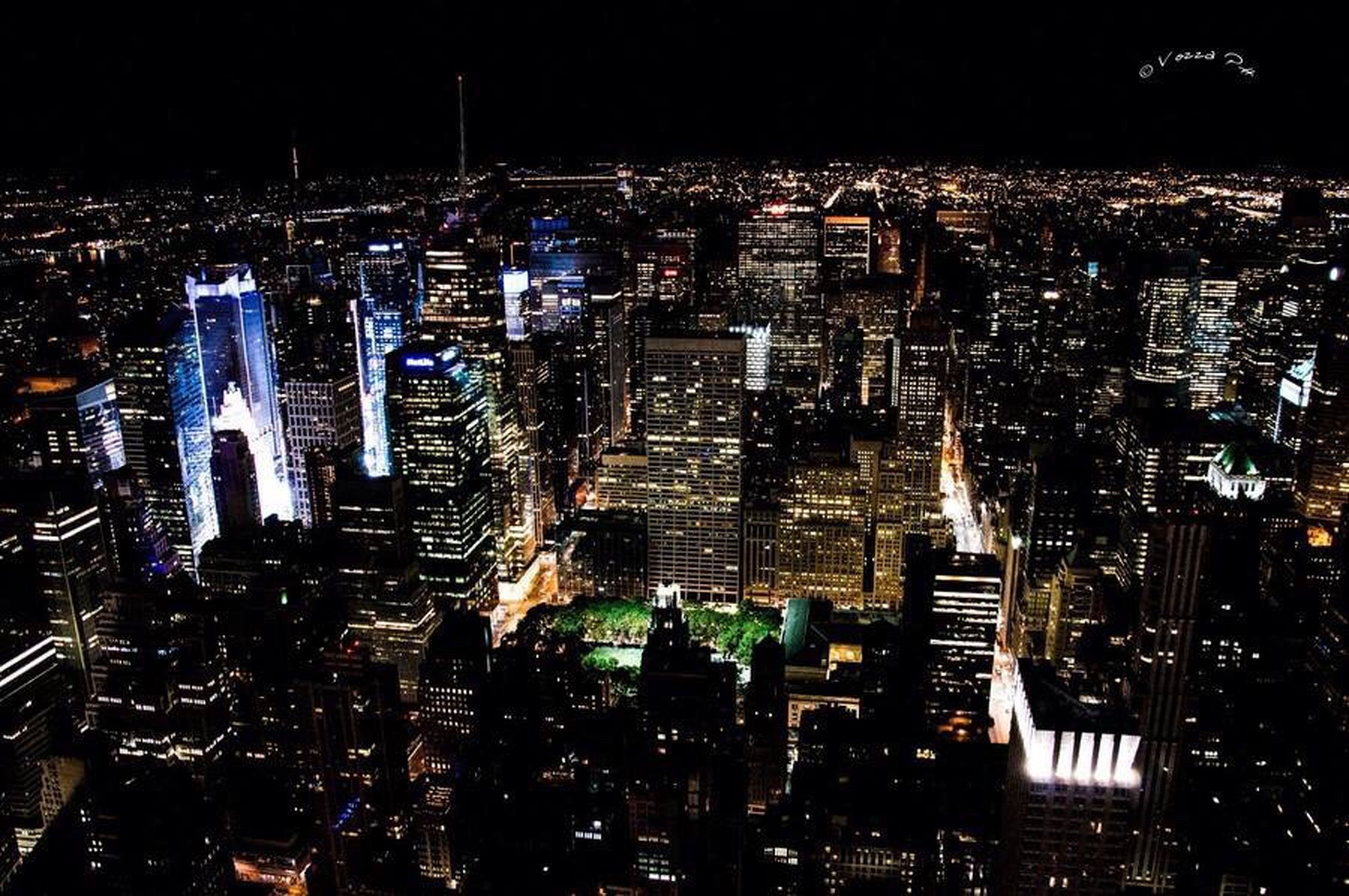 architecture, building exterior, built structure, city, night, illuminated, cityscape, high angle view, skyscraper, water, tall - high, residential building, modern, tower, residential district, city life, office building, development, residential structure, crowded