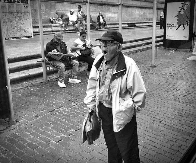 Architecture Building Exterior Built Structure Casual Clothing City Day Full Length Holding Lifestyles Looking At Camera Mask - Disguise Outdoors Person Street Photography Streetphotography Yawn