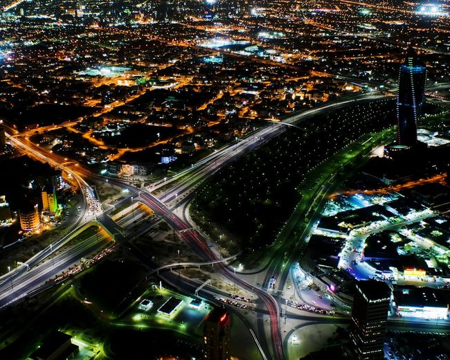 Battle Of The Cities Kuwait city at night Kuwait Kuwait City كويت الكويت مدينة_الكويت City Cityscape Night Illuminated Aerial View Built Structure Architecture Transportation Road Building Exterior Connection Travel Water Mode Of Transport City Life Multiple Lane Highway Crowded Elevated Road Modern