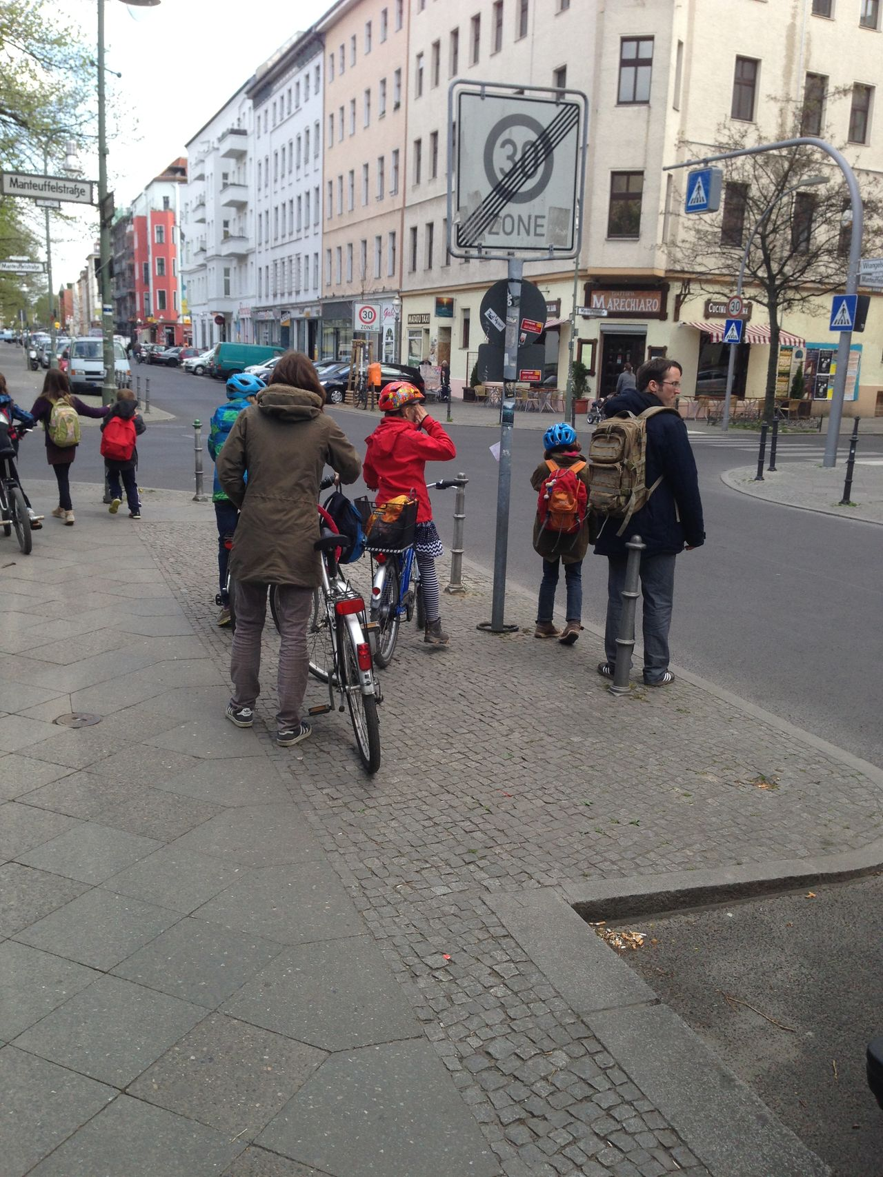 Kids Parents And Children Going To School Back From School Street Biking