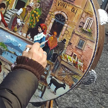 scorre arte nelle vene #Painting #Creating Colors Streetart Naples One Person Real People High Angle View Holding Outdoors